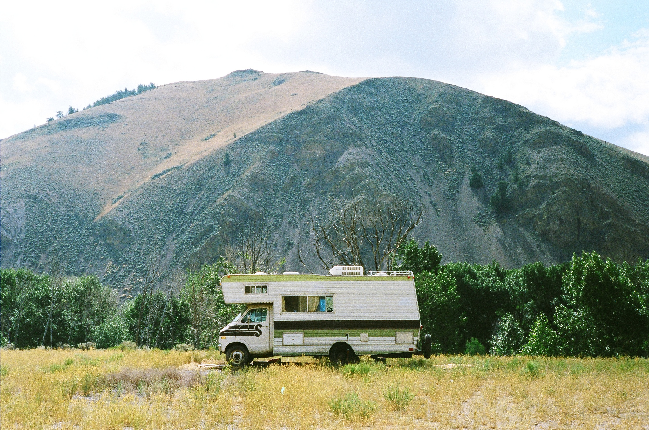 Cody Barnhill's RV, Harvey hiding behind the trees at Idaho Base Camp.