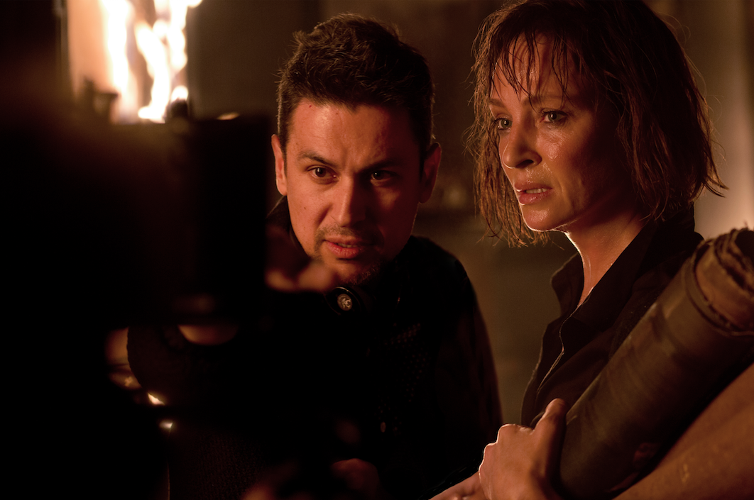 """Director Rodrigo Cortés with actress Uma Thurman, on the set of his upcoming feature film """"Down A Dark Hall""""currently in post-production."""