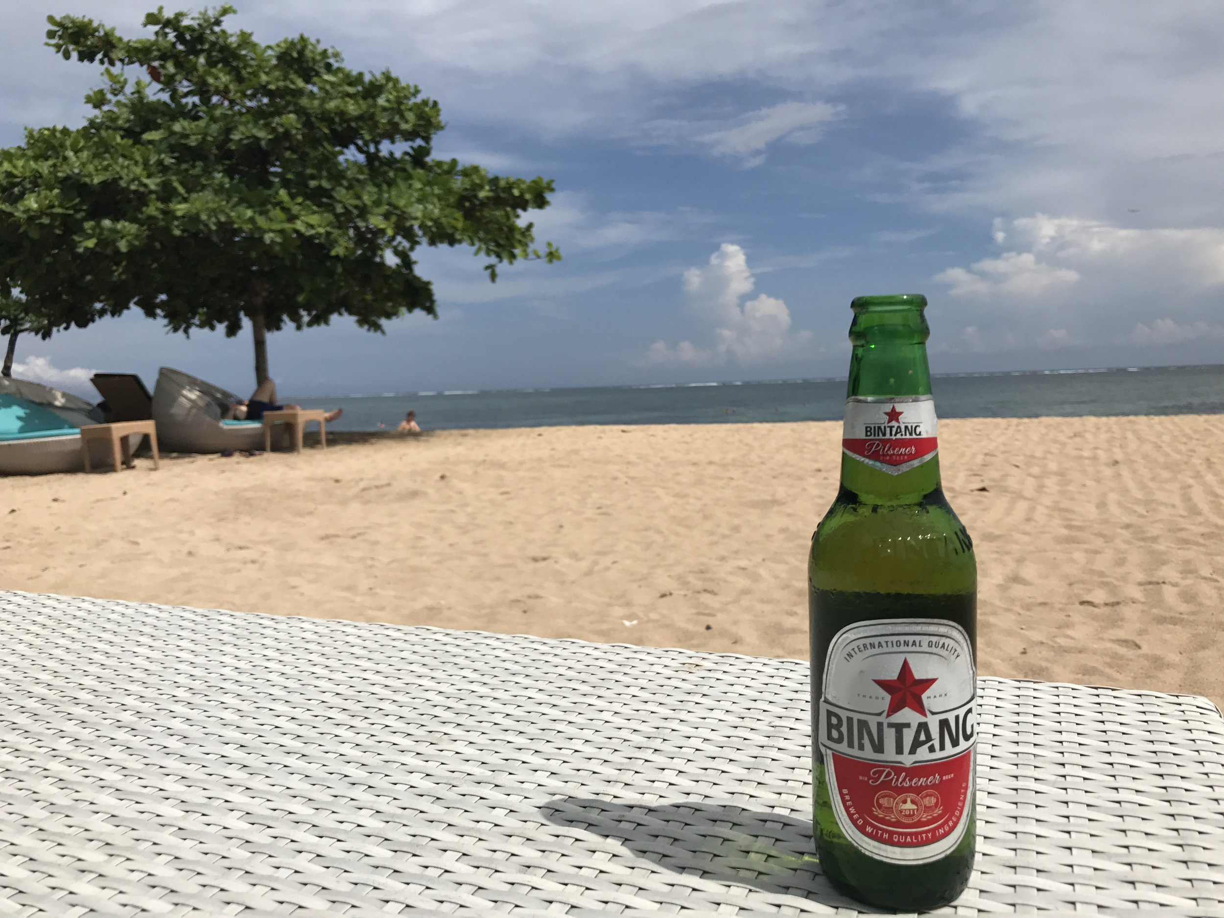 Ice cold Bintang beer helps to cool you down on a sunny beach.