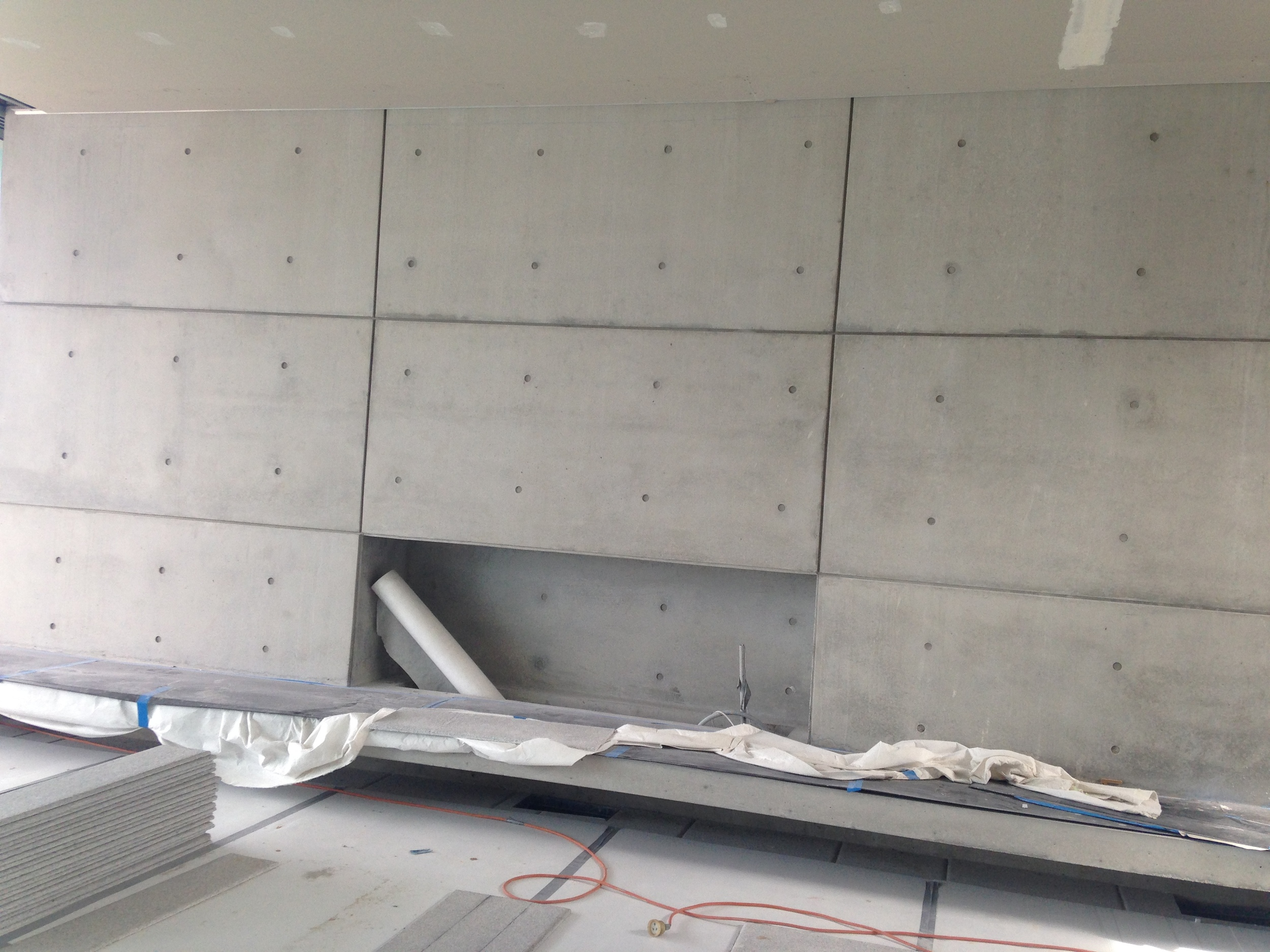 The off-form bare concrete creates a stunning feature wall.