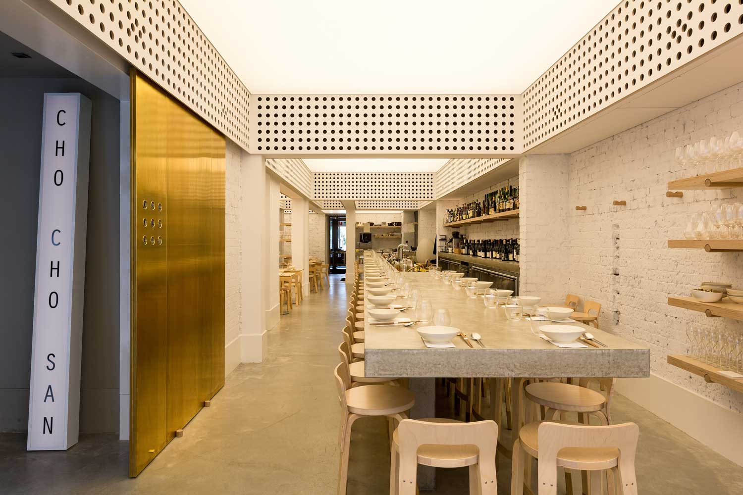 We love the interior of  Cho Cho San  by George Livissianis with its back-lit ceiling that provides warm and ambient light for daytime and evening dining. The stretched Barrisol ceiling is a unique design feature that creates subtle lighting in what was a cavernous space with little access to natural light.