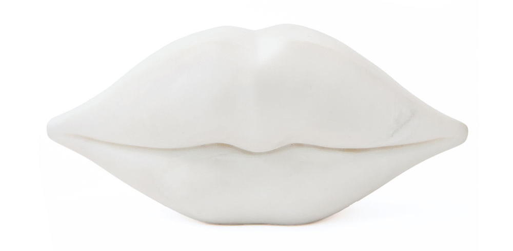 Alex  is loving Kelly Wearstler's 'Classic Little Kiss' hand-carved marble lips made from white Calcutt  a  . Available at  Becker Minty.