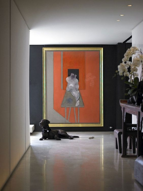 The burnt orange in the artwork is the perfect accent to the indigo walls of Donna Karan's Manhattan apartment.