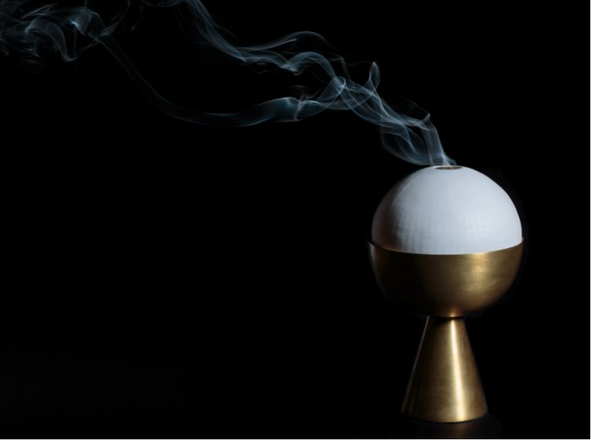 Burn incense to ignite the allure of wafted scented smoke from the hand-cast porcelain dome, or strike a match to a candle and transform the 'Censer' into a brass torch that emits a soft glow during the long dark evenings.