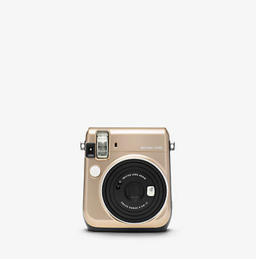 Demi is going to shake it like a polaroid picture this Christmas with the limited edition Michael Kors X FUJIFILM Insta Camera available at  Michael Kors.