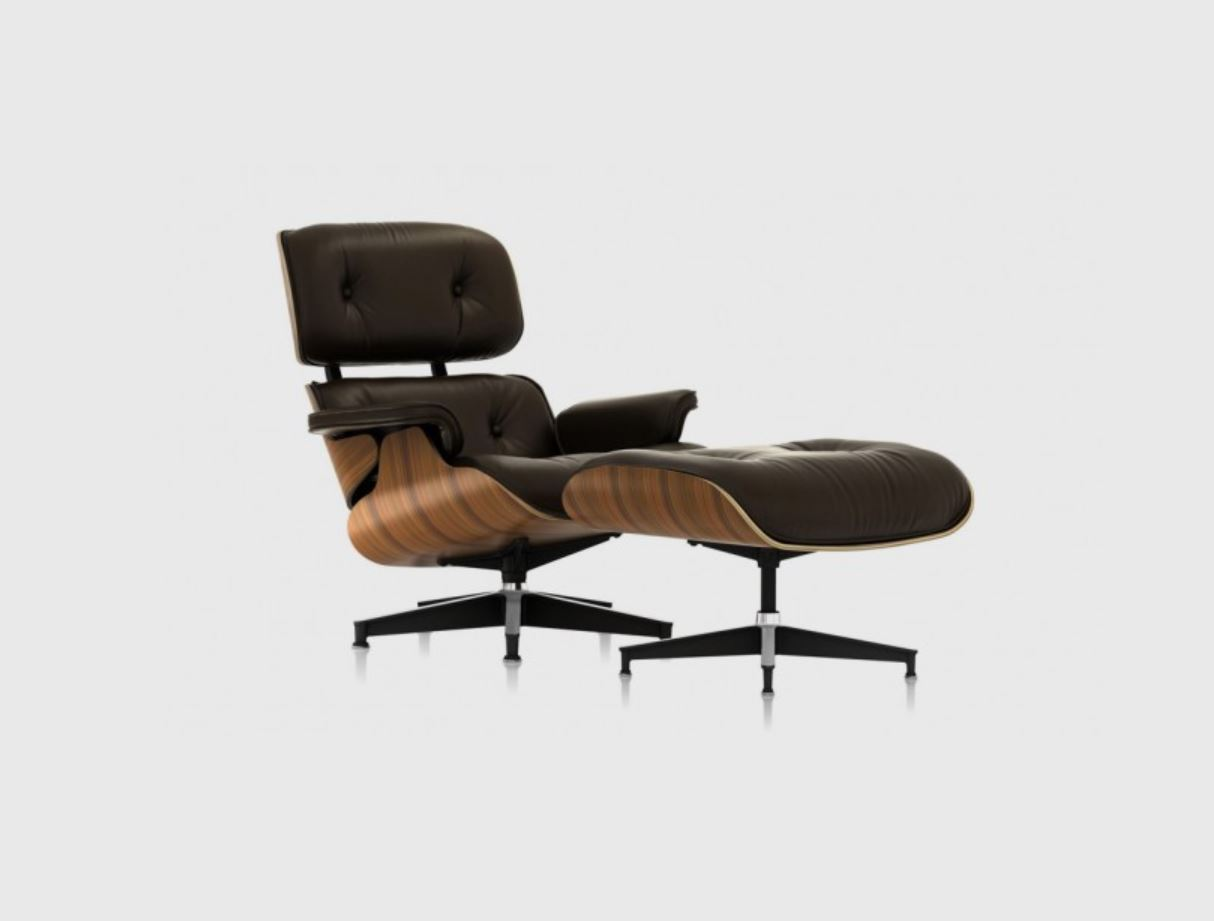 The classic  Eames Lounge and Ottoman  is perfect for a gentleman, particularly in this deluxe walnut and black leather combination. Ideal for a relaxing recline or to nurse a new baby to sleep!