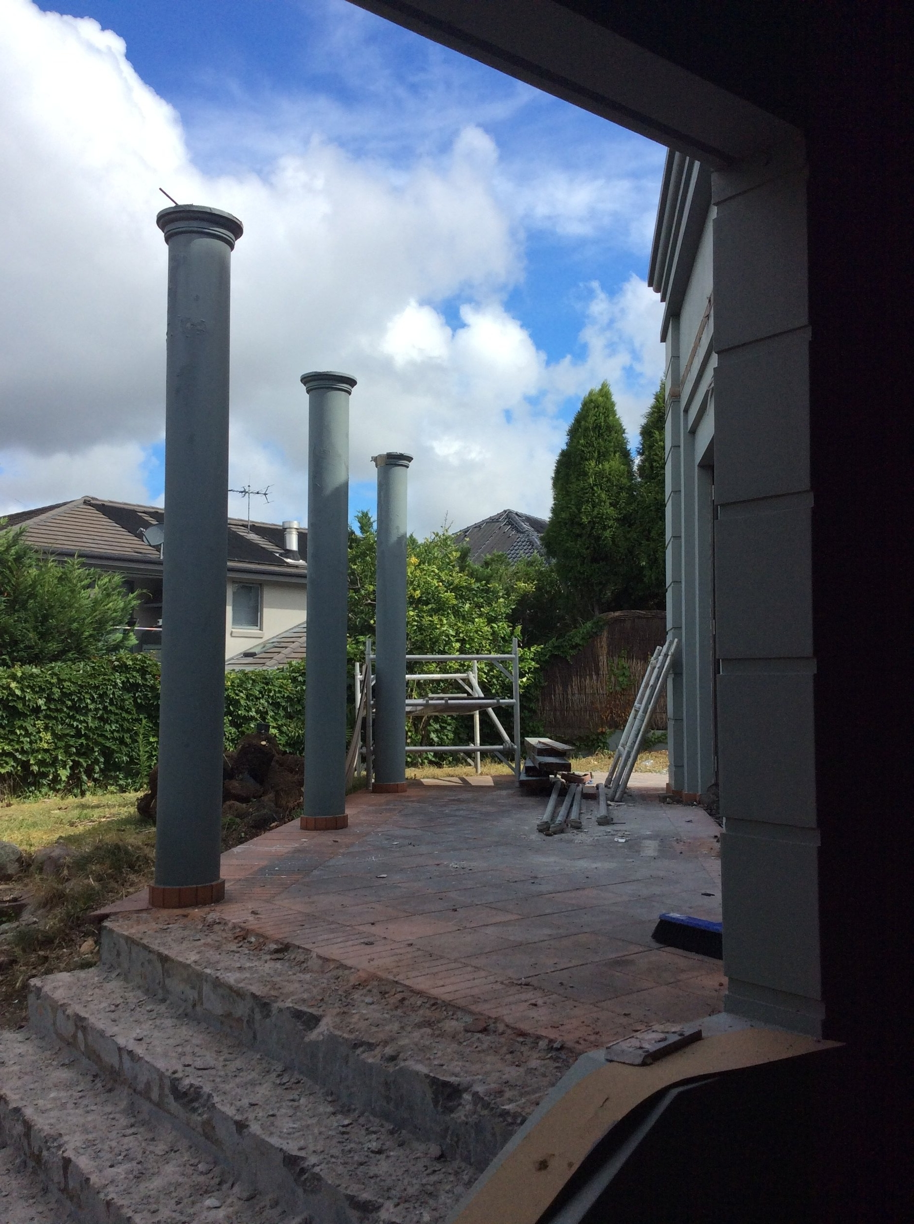 One of the many terraces receiving new tiling and stone edging. The existing round exterior columns are to be removed and replaced with a new contemporary spotted gum pergola.