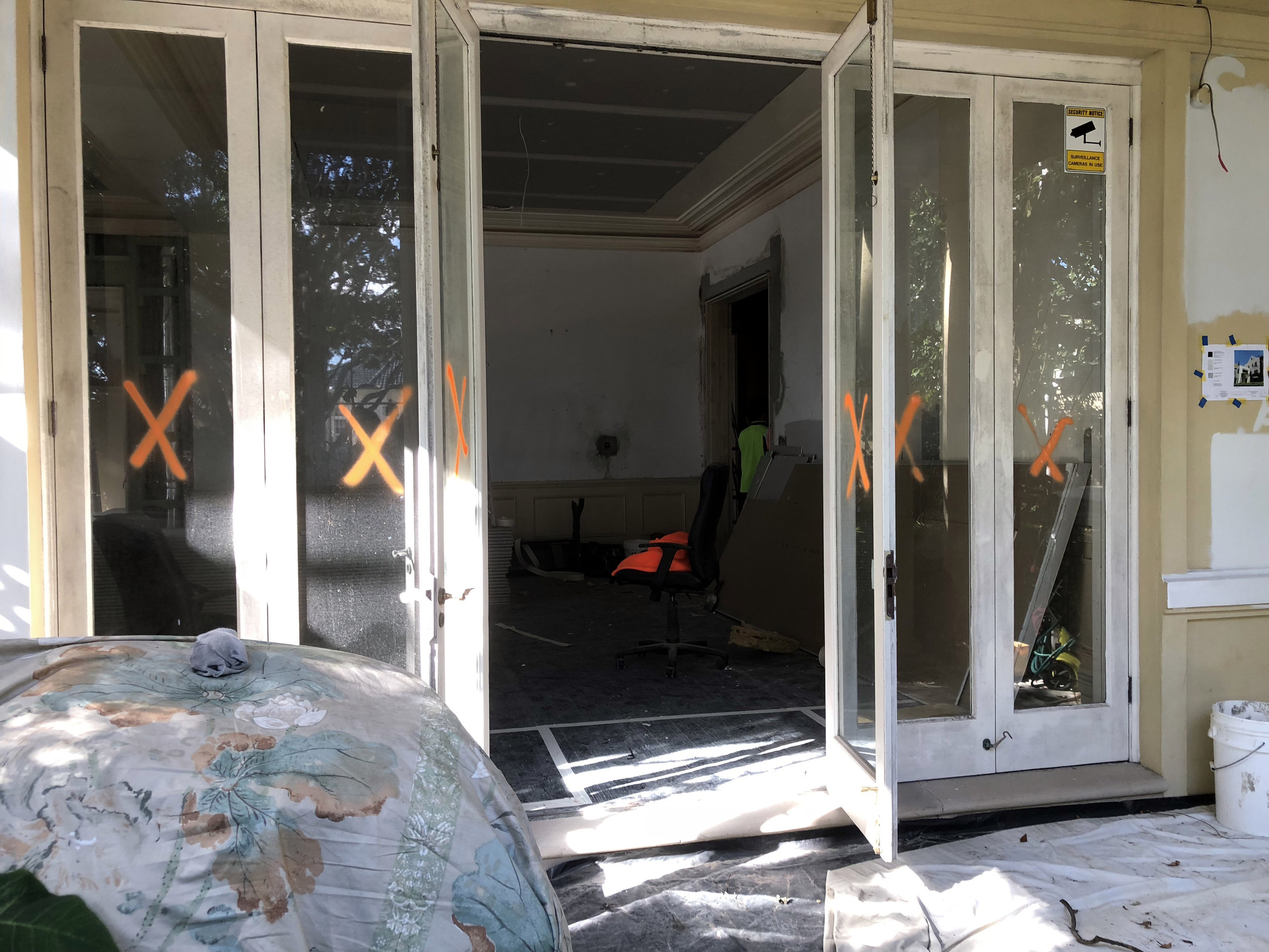 We are saying goodbye to the old bi-fold timber doors and are almost ready to welcome our new steel doors with their small profile and very elegant transom details.