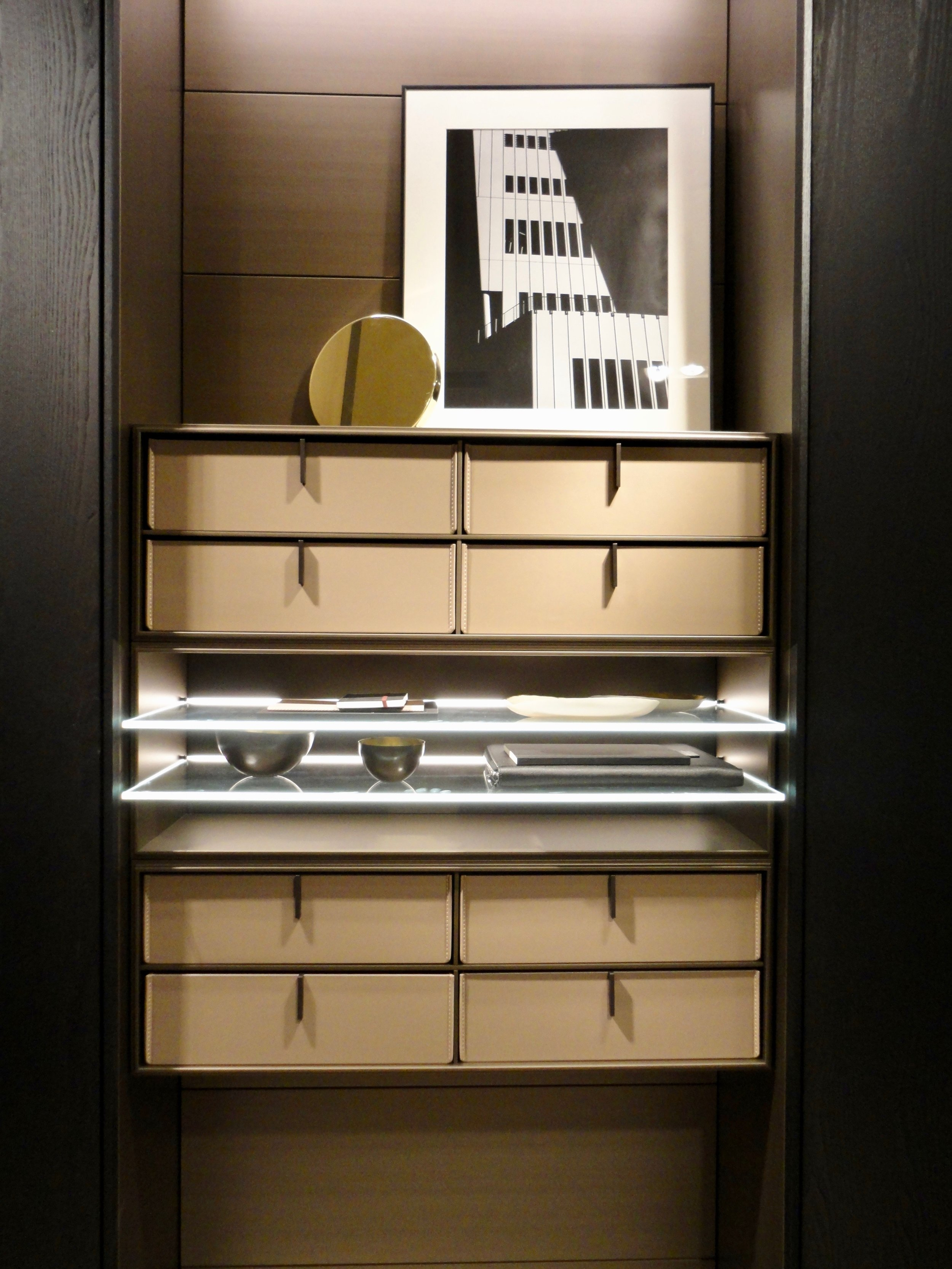 Leather drawers to an open robe display section