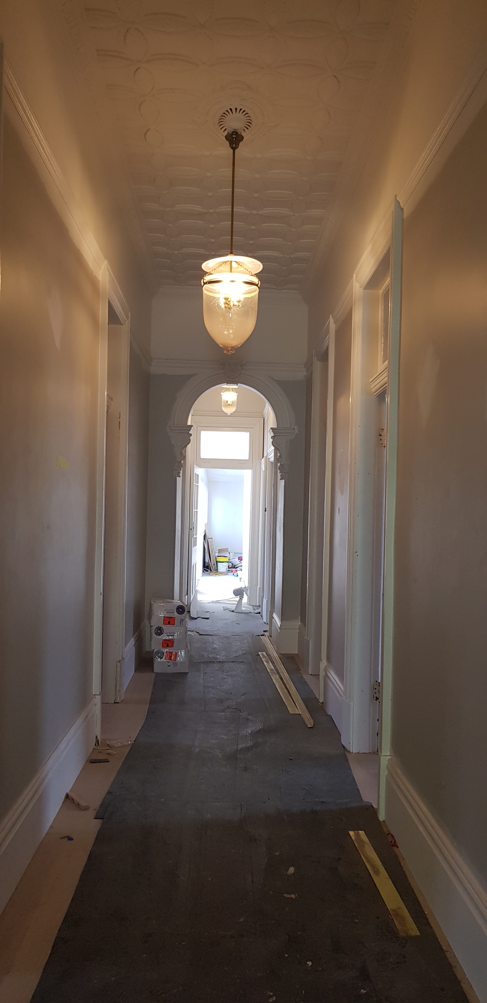 The hallway features an original horsehair plaster ceiling.