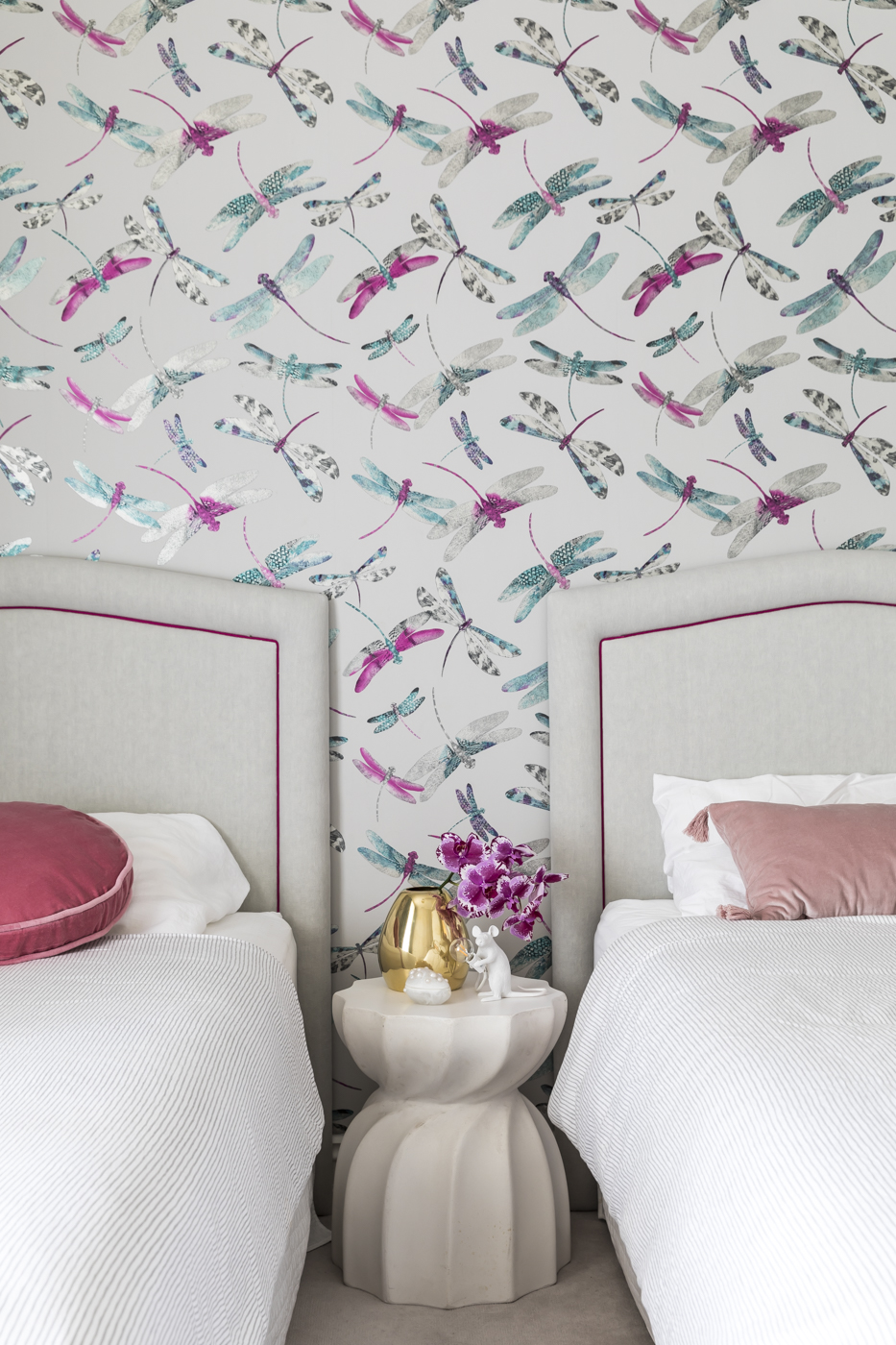 In our    Jersey Road    project, we chose a base palette of soft greys with pops of pink and turquoise for an element of playfulness. Wallpaper by Matthew Williamson.