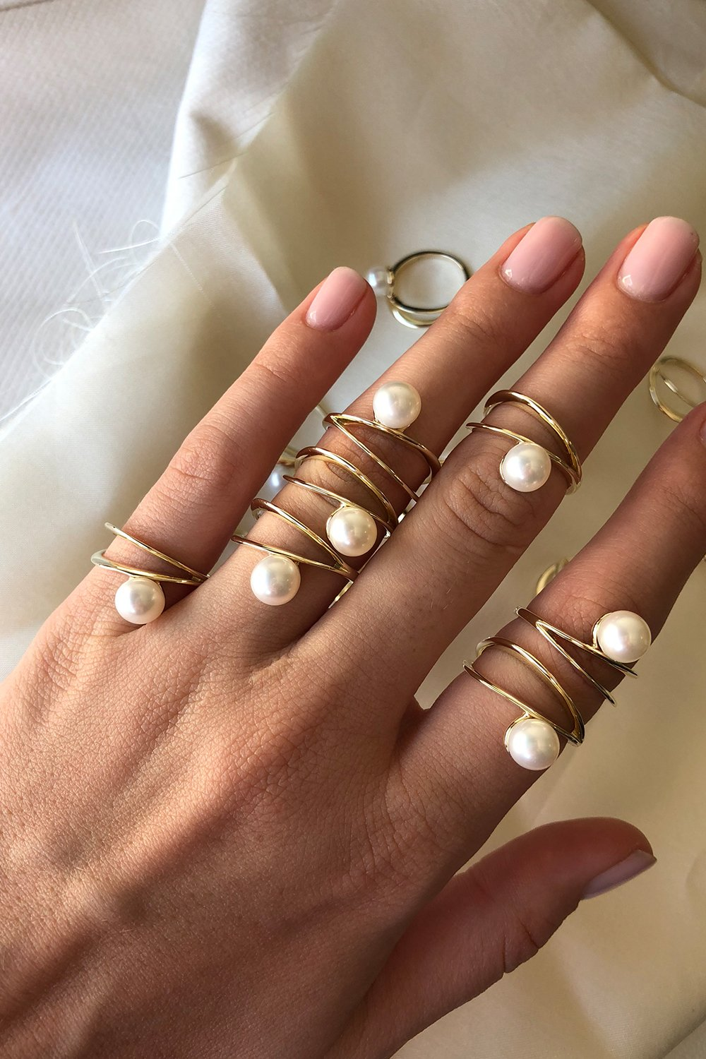 A contemporary twist on the old-fashioned pearl, we're already adding this    sculptural, double-band ring    to our carts. One for us, one for mum… right?