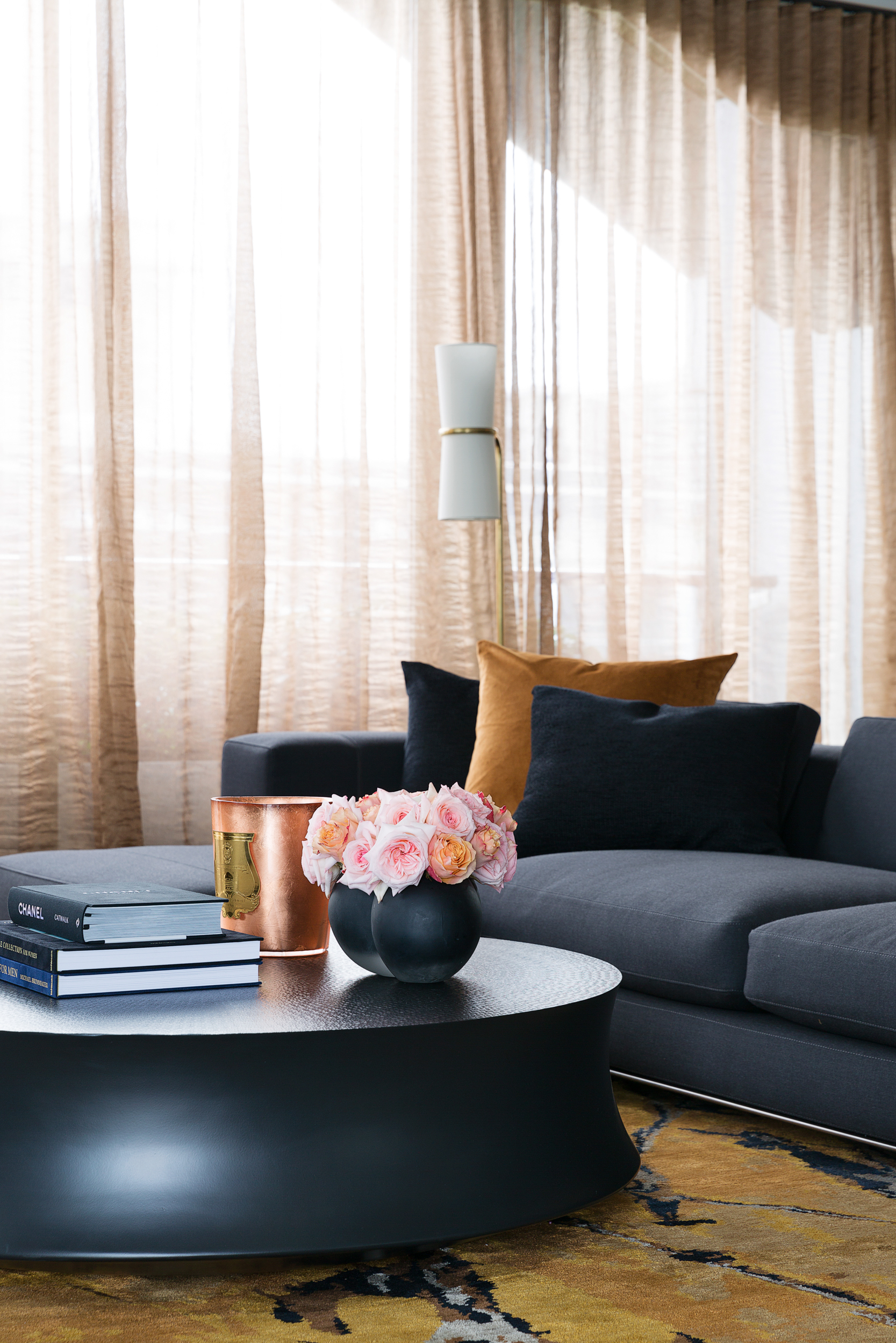 At Wharf Crescent, a copper candle from Cire Trudon gives the living room a toasty glow.