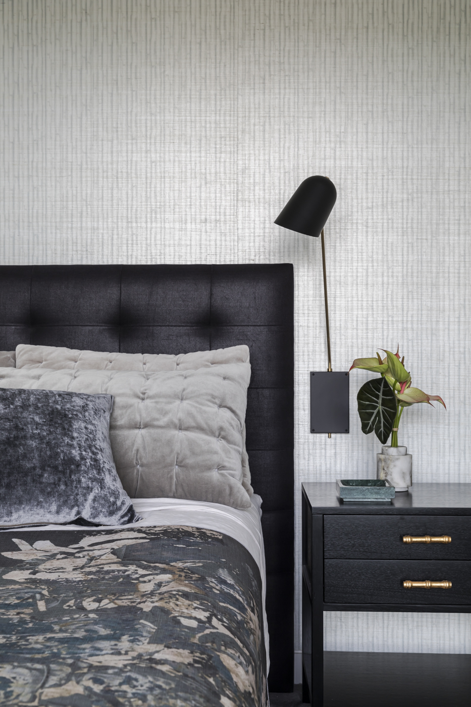 The darker shades in Raglan Street's master bedroom contrast with the lighter wallcovering to add depth and drama.