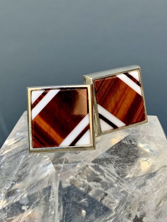 Rick Southwick Sterling Silver Cufflinks    Go full luxe with these handcrafted cufflinks made with tiger's eye and white jade