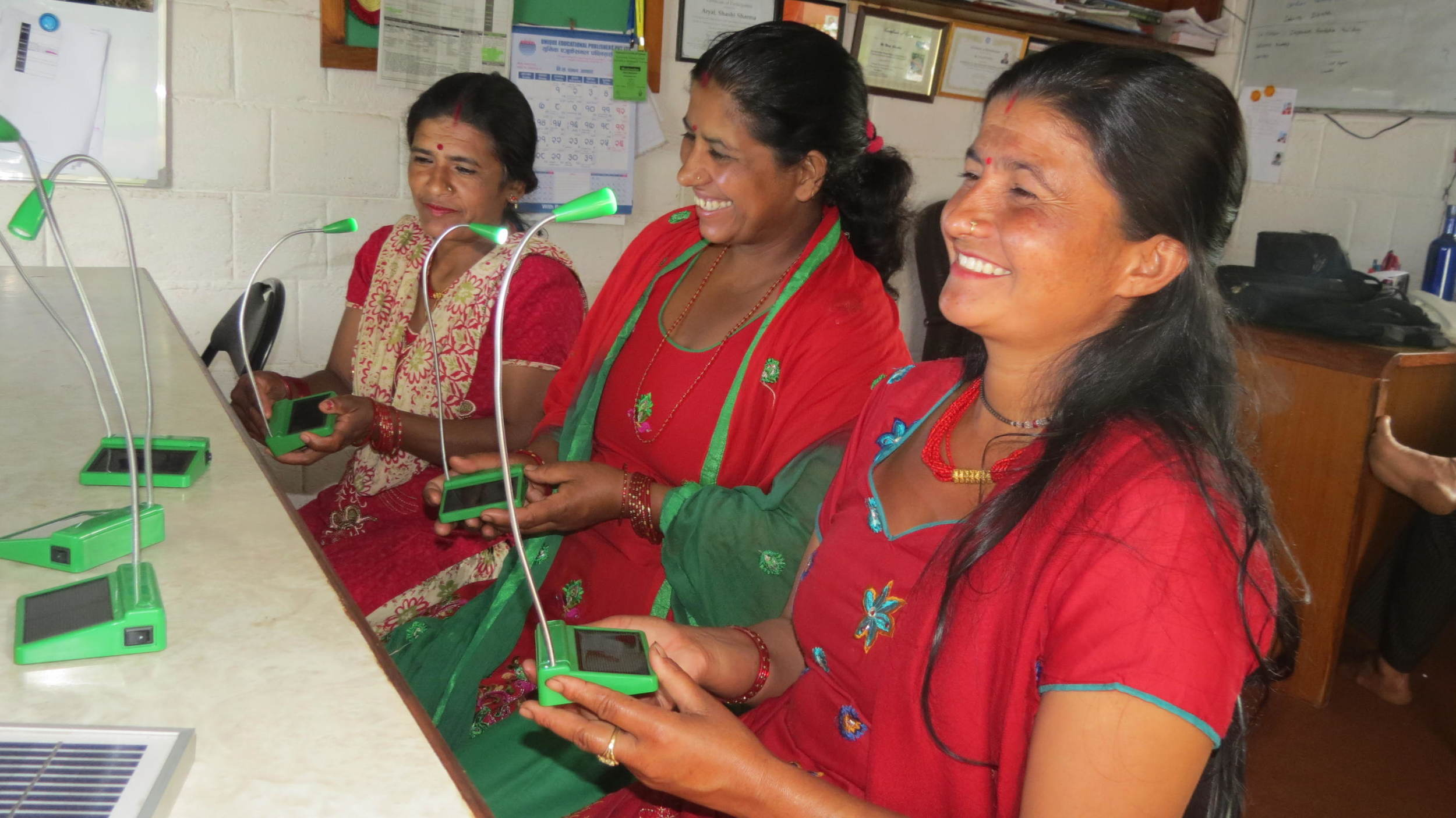 mothers of Anjana, Nirupa and Sajani observing solar lights with curiosity.JPG