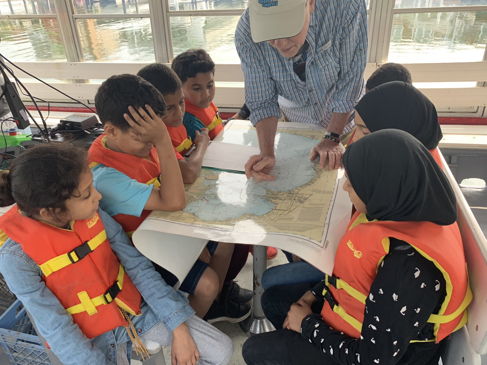 Students from Dearborn's ACCESS, a 21st Century CLC program, learn about life on the Detroit River while touring on the 'Schoolship' Clinton in July 2019.