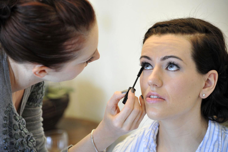 Applying makeup to a hottie