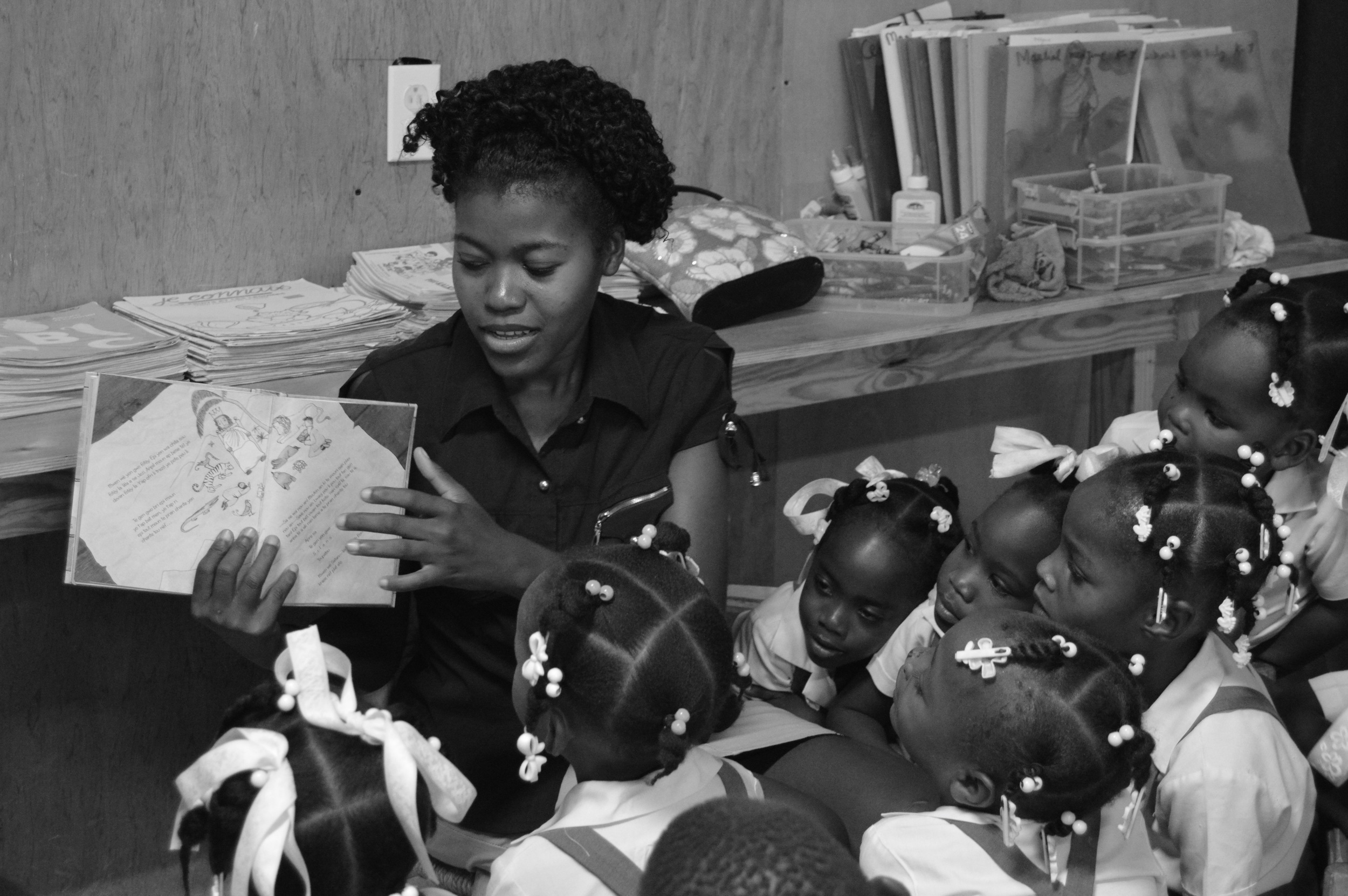Madam Worcarline leading her class in their weekly Bible story