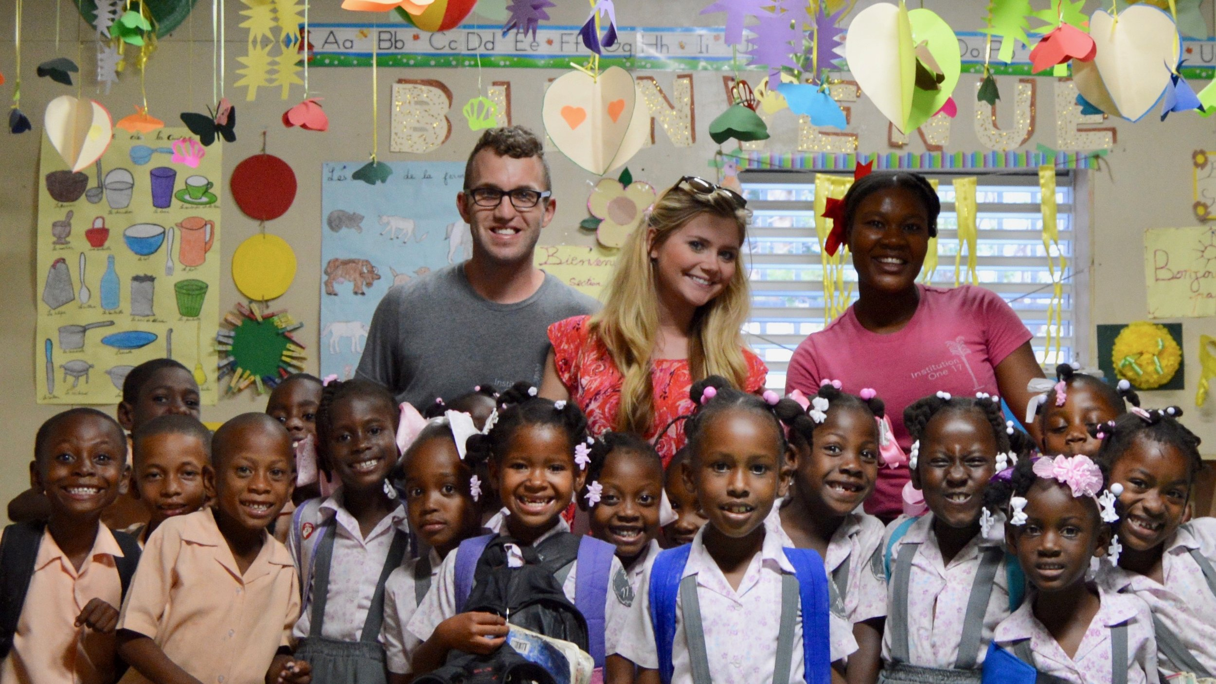 Serving at our school in Haiti with my wife, Britanny.