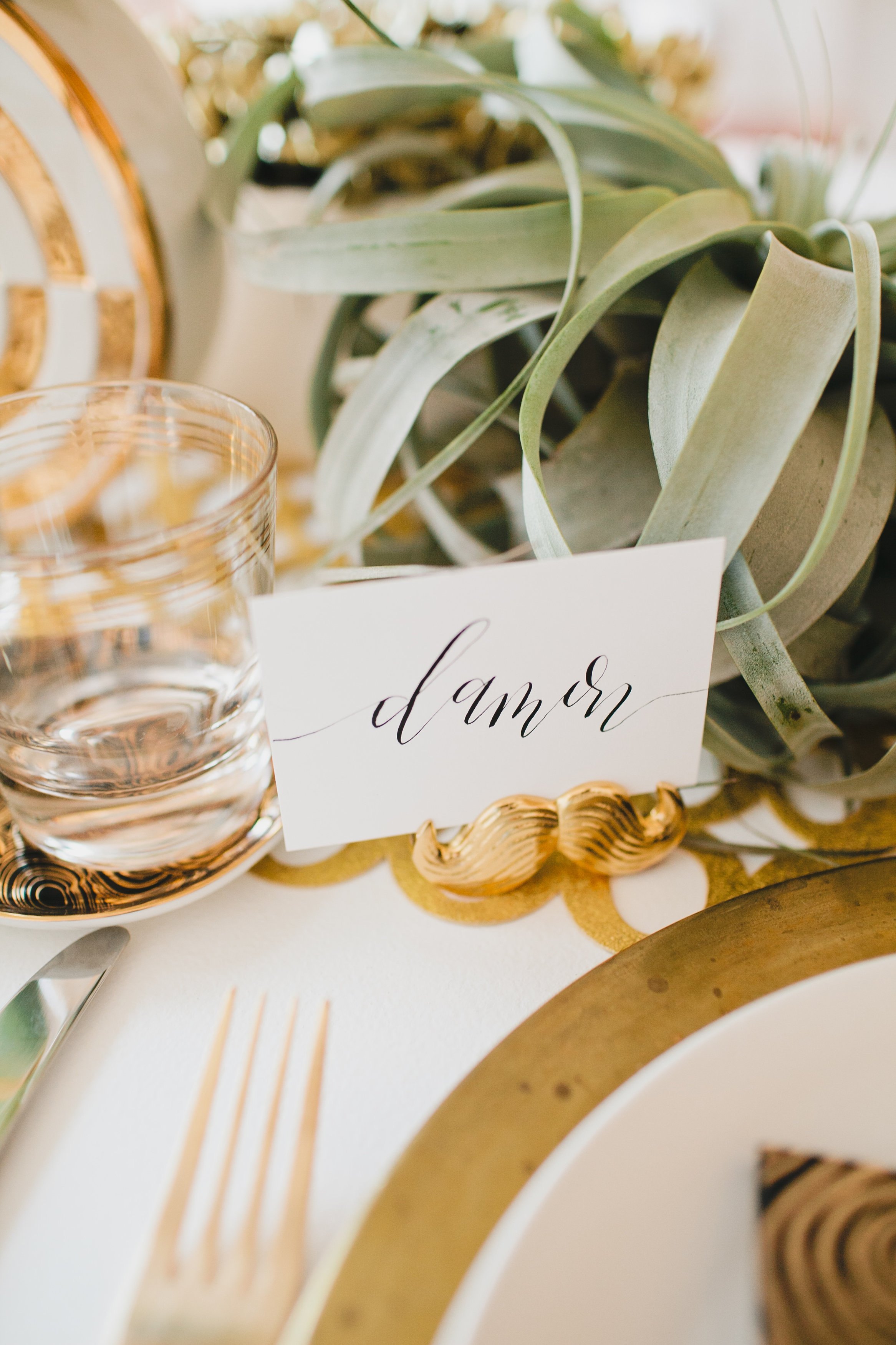White and black calligraphy place cards