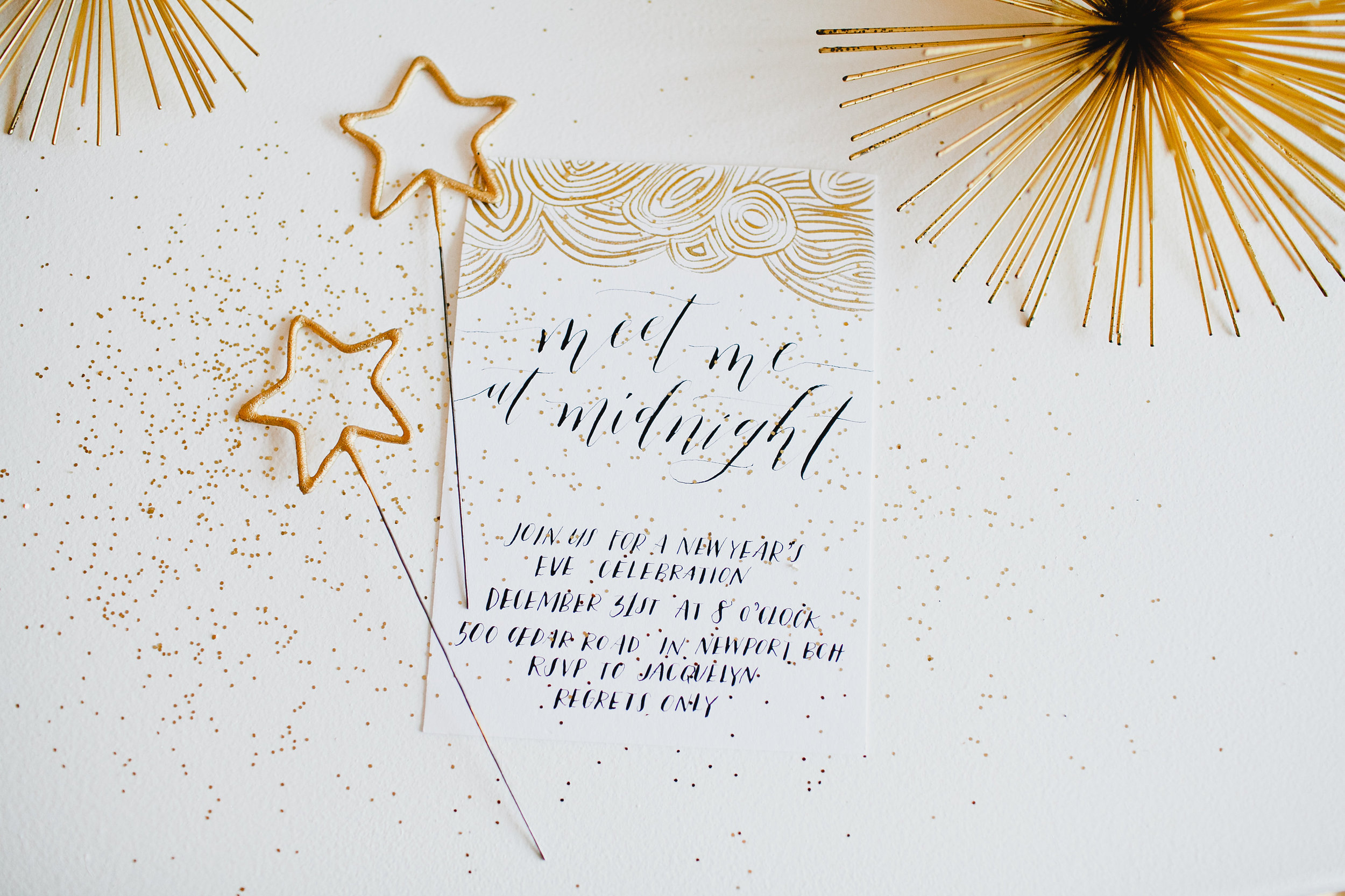 White and gold New Year's Eve invitation