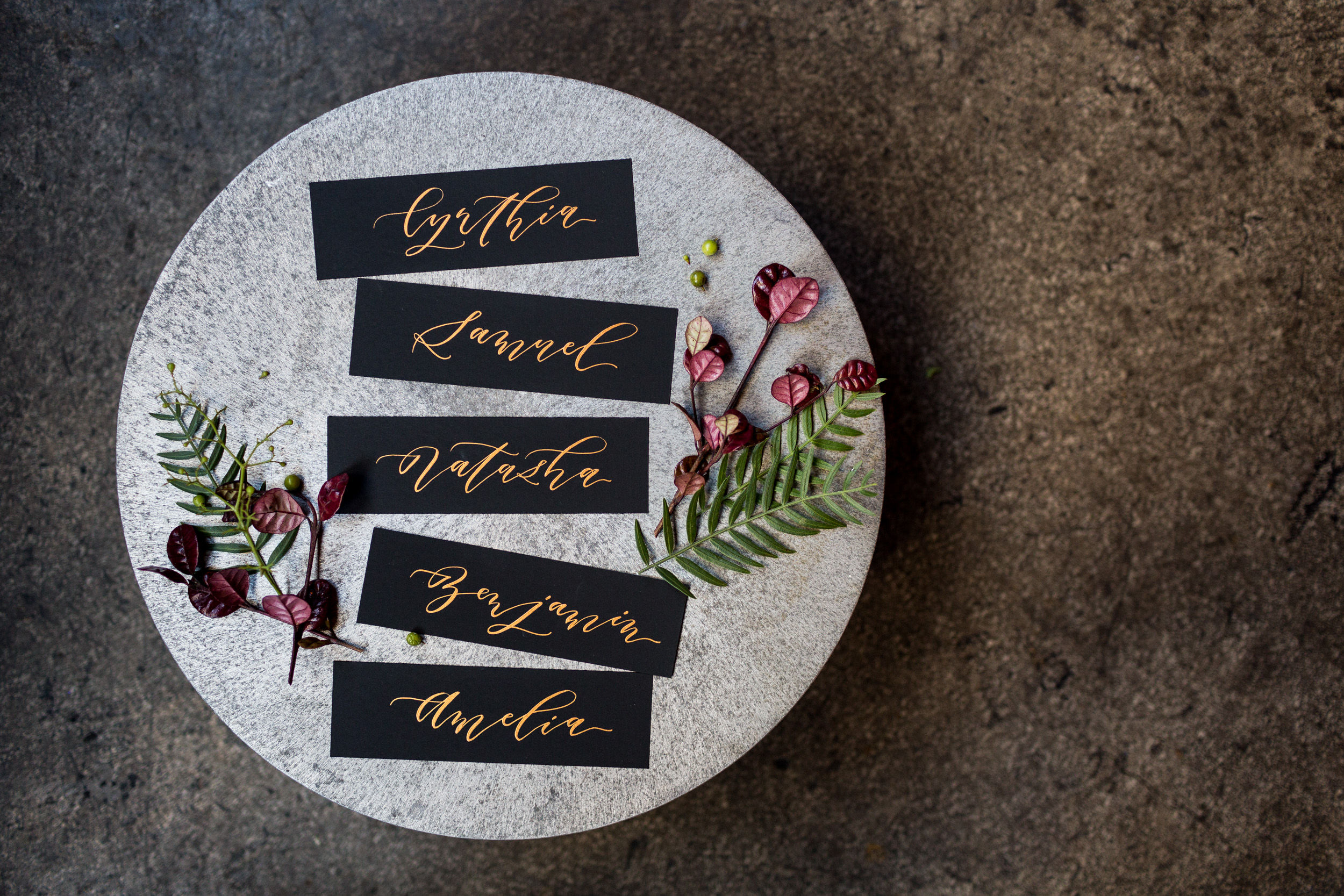 Gold and black calligraphy place cards