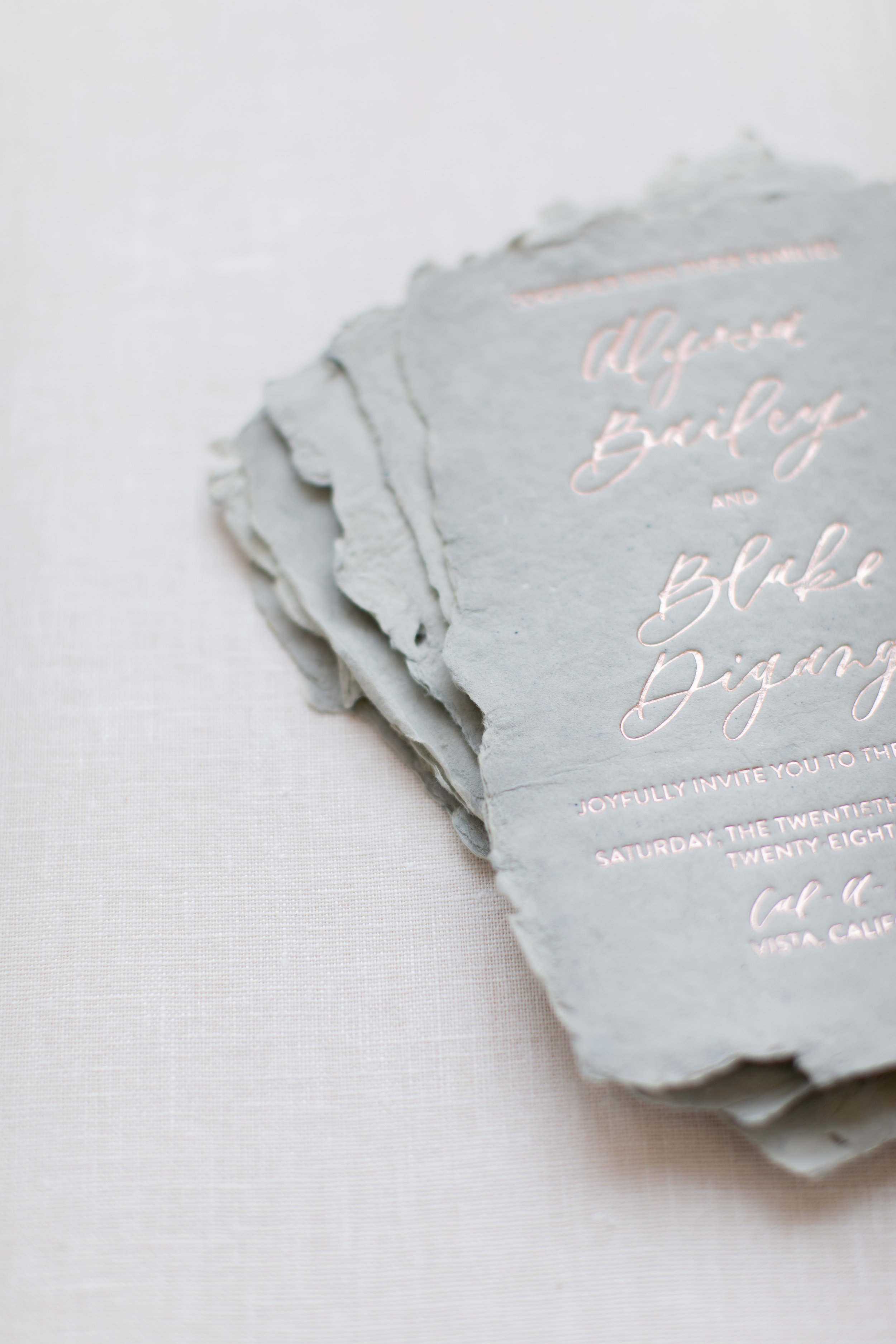 Handmade paper invitations with deckled edge
