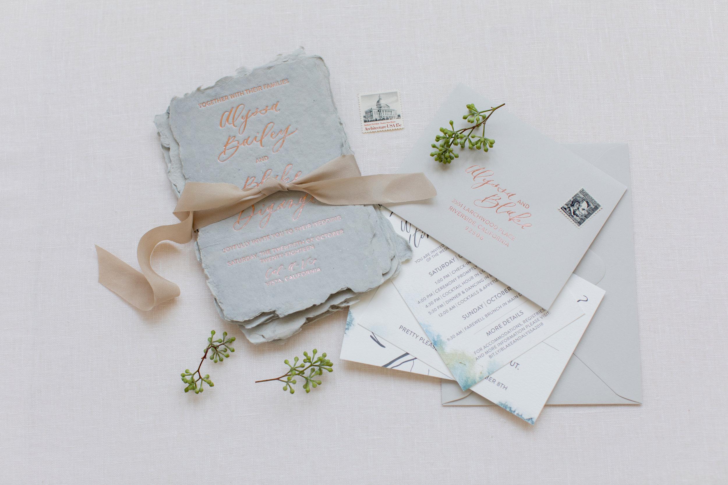 Dusty blue handmade paper wedding invites