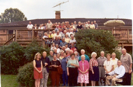 Group shot of the DC mob of classmates assembled at Dick Trefry's farm in Clifton, VA on 25 Sept 2004. This has become a near traditional party, sponsored each year by the classmate members of the Army-Navy Club in DC. Close to 100 in attendance. Wonderful party.