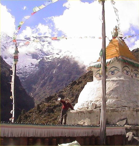 Dave Hughes installing wireless for Sherpas on a Buddhist Stupa in Namche, Nepal on the slopes of Mt. Everest. November 2003. The mountain behind is 20,644 feet high. Had to Trek 2 days up to the 12,000 foot town to carry the radios.
