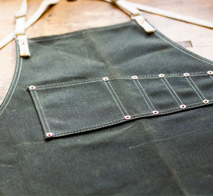 Shop Aprons - The durable material moves freely with your body, held in place with leather straps that cross over the shoulders, eliminating the neck fatigue.