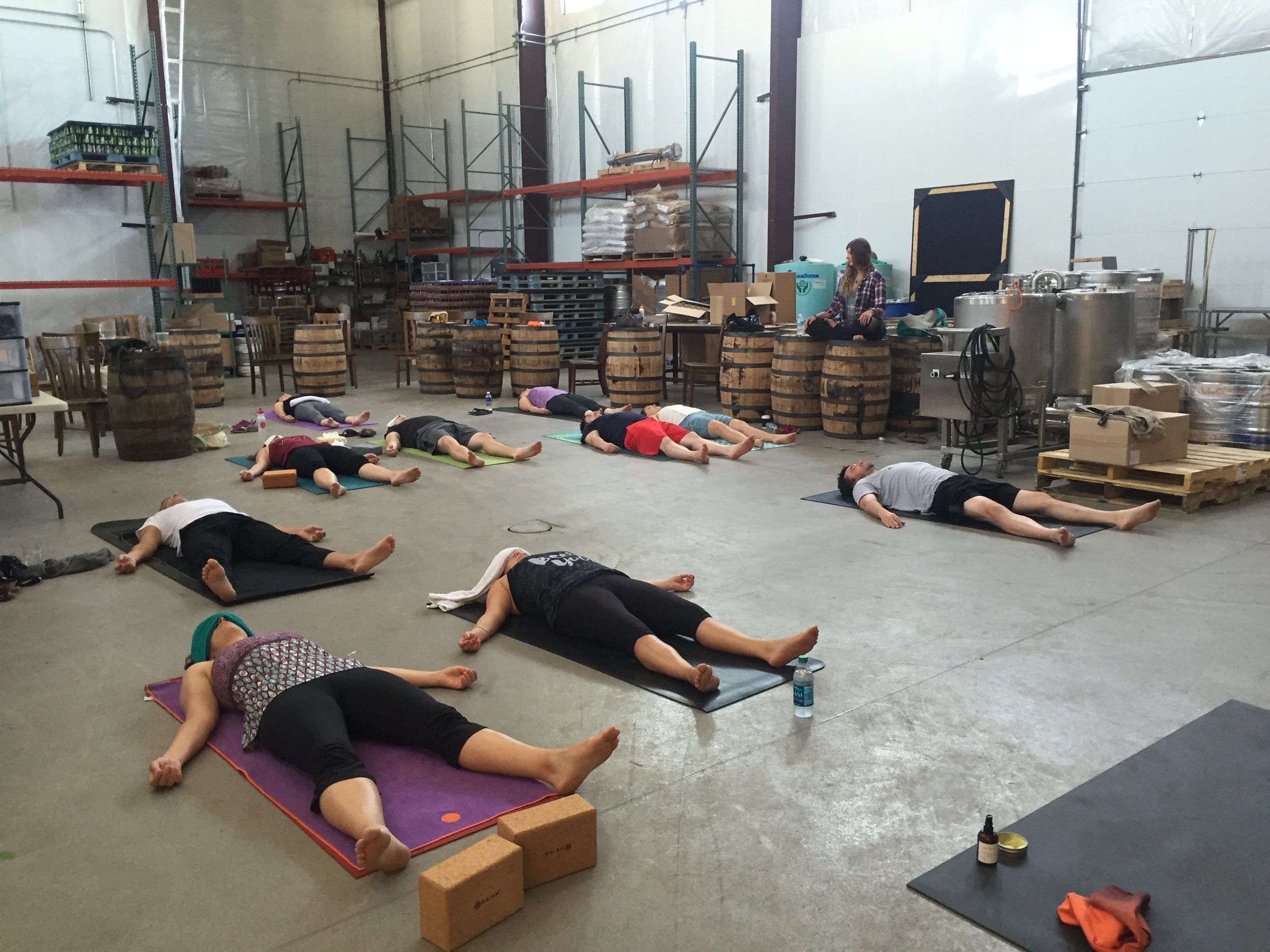 'Nidra light' at this past summer's yoga & beer retreat,   balance on the road: Jackie O's 2016  . Though a dark, warm, quiet space is most ideal for yoga nidra, sometimes life and brewery floors just want what they want!