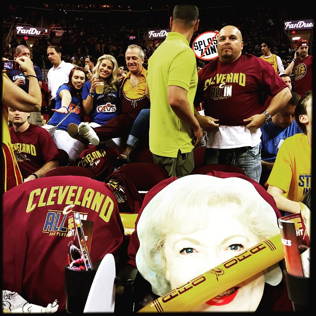 As the likeness of Betty White is propped up on a seat, Gary Borstelmann, aka Amazing Sladek, he of the death defying tower of chairs halftime act, poses for a photo with Cavaliers' fans before Game 6 of the NBA Finals. You don't see that everyday. Photo by @scottstrazzante #icausebeautiful #Cleveland #NBAFinals #Hipstamatic