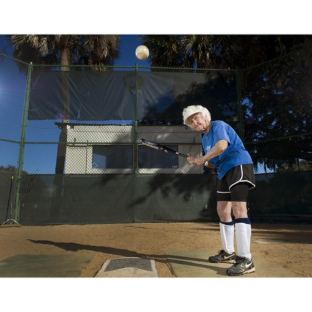 """#ICauseBeautiful #Florida #stereotypes #retirement #seniorstereotype #TheVillages #Portrait #Photography #selfrealization #happiness #softball #foreveryoung #love #homeplate #AARP #inspiration """"I love the game. As I grow older I know I'm going to have to stop and I'm not looking forward to it. I will play as long as they put up with me."""" Bertha Burk, of Epsyille, Pennsylvania and Ravenna Ohio, worked at the Ravenna Arsenal during WWII and started playing softball as a sophomore in high school.  Burk no longer plays due to health reasons. The last time I spoke to her I could detect defeat in her voice now that she could no longer play the game she loved so much. Your thoughts and comments are welcome."""