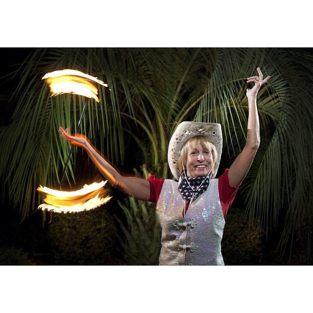 """#ICauseBeautiful #Florida #stereotypes #retirement #seniorstereotype #TheVillages #Portrait #Photography #selfrealization #happiness #baton #flamingbaton #sequin #palmtree #twirlers """"I was a twirler when I was a kid. Then when I saw it listed in The Villages Lifelong Learning College book, I said, 'Wow! I'm getting into that!' That's how we started The Villages Twirlers. It took five years to get the drummers in there. We started out with seven or eight drummers and now people are waiting to join all the time."""" """"I really like the people and I like the excitement of performing actually. My goal in life is to help put us out there. It's pretty awesome what we do."""" Ann Pelle, a retired Century 21 real estate agent from Walford, Maryland, who was inspired by the baton-twirling by fellow resident Judy Marshall and founded the Villages Twirlers after taking classes from Marshall. @wanderluster800"""