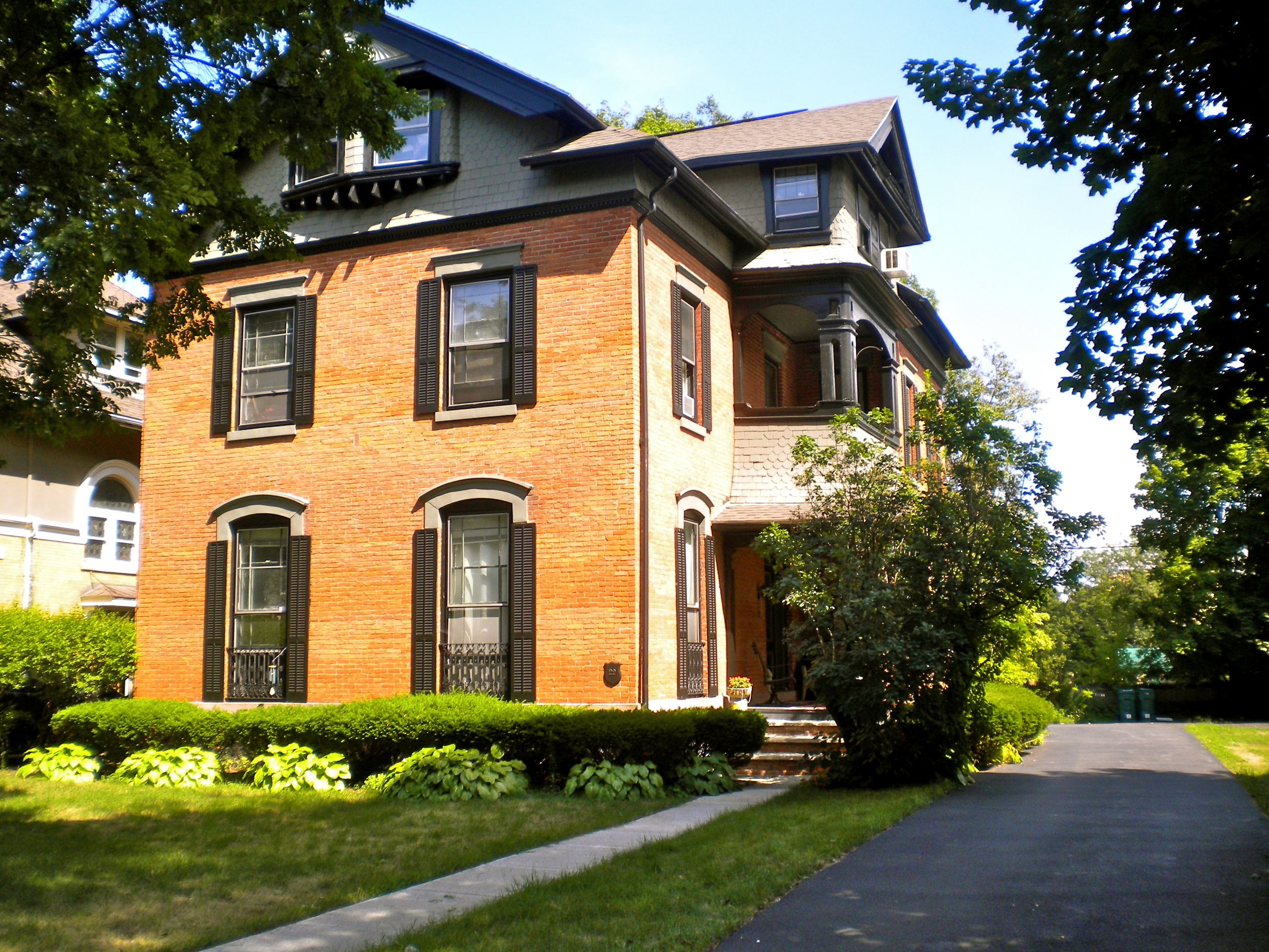 A charming Victorian house on a highly sought after quiet, tree lined street in Neighborhood of the Arts, the cultural center of the City of Rochester.