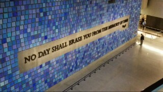 """Each tile represents a victim on that day when the skies were blue. The quote is from Virgil, """"No day shall erase you from the memory of time"""""""