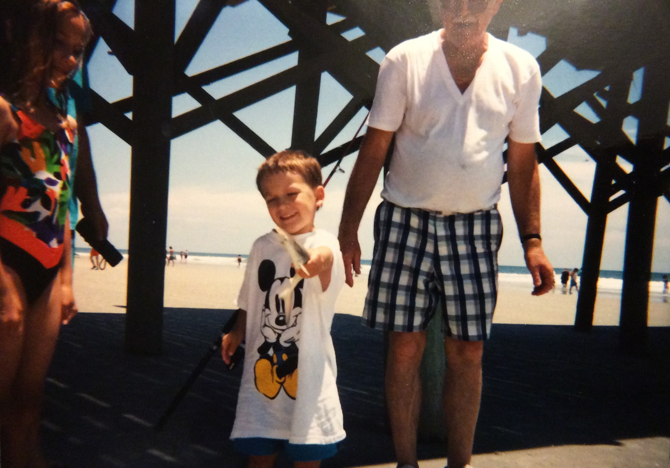 my sister, myself with a small shark, and my grandfather in myrtle beach; circa 1993ish