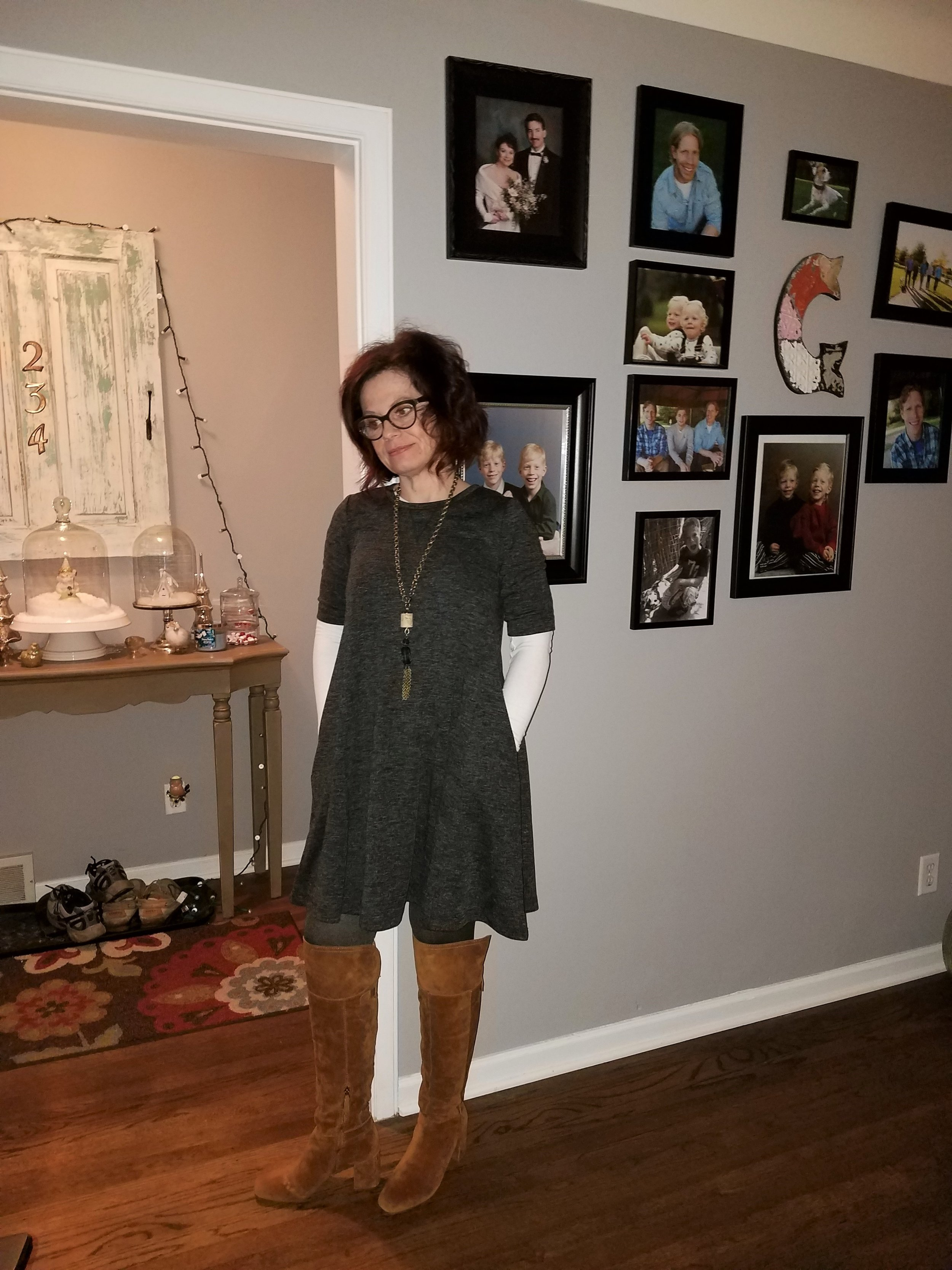 This is a short, A-line dress from Andrea Jovine that I purchased recently at TJ Maxx for less than 30 bucks! I wear opaque tights and over the knee boots with it. I would not wear a dress this short without opaque tights. In the spring I may pair this with a pair of cropped leggings and flats or booties. A woman under 30 I feel, could wear this shorter length with bare legs and make it look great.