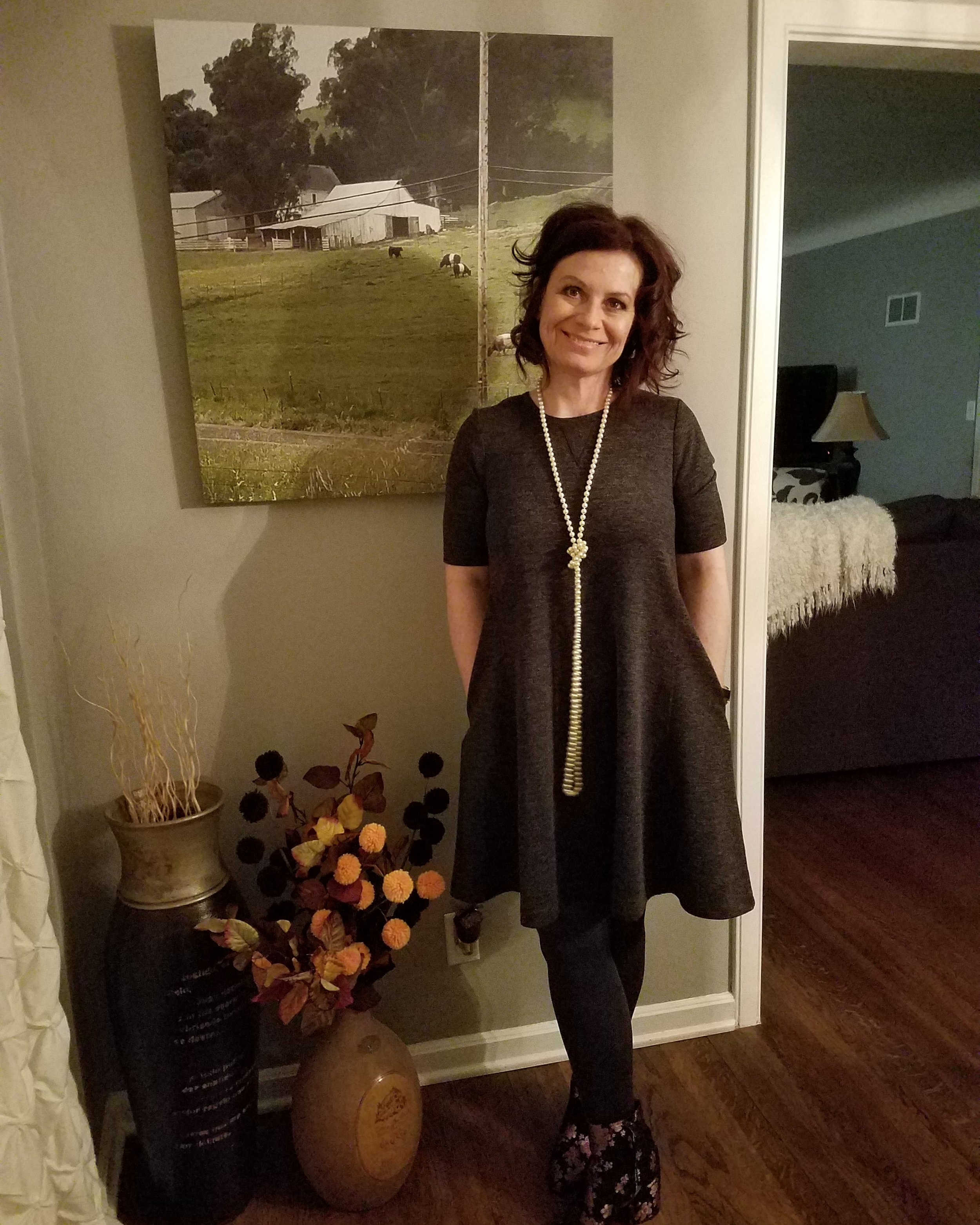 Here's the gray dress again. This time dressed differently to celebrate my favorite film student's birthday. Paired with tights and floral booties - love this! A simple dress in a neutral color can really be worn so many different ways.