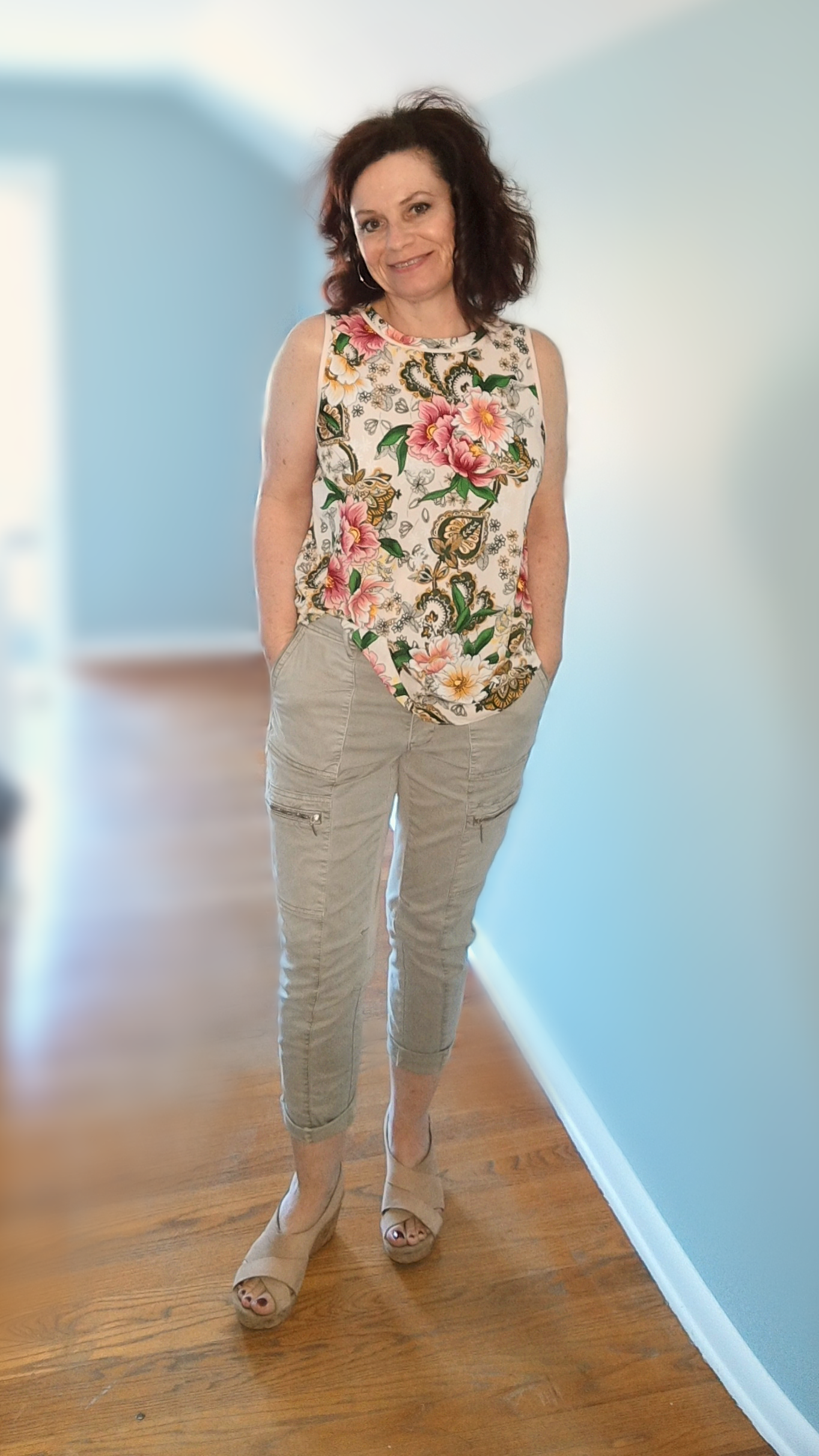 I started with a sleeveless top and simple pair of khakis... - I started with the top. It's a great print and it's sleeveless. What I love: all the colors in the print give me a ton of options for the layering pieces, bottoms and accessories. Because it's sleeveless I have many more options for layering, but also for wearing alone if temperatures are warmer because it's not just a camisole.
