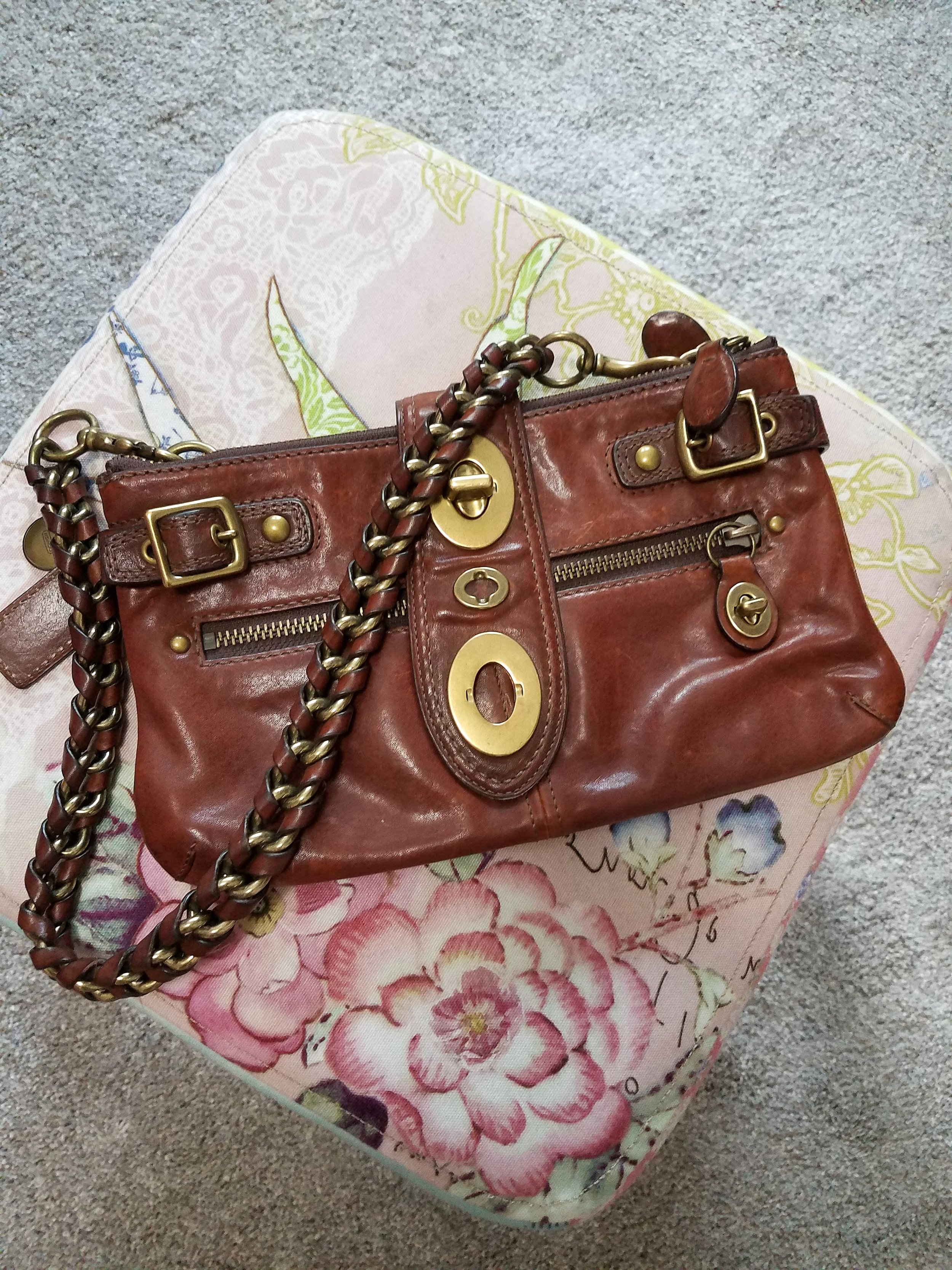 Vintage Coach - I purchased this lovely at one of my favorite consignment stores in Grand Rapids.  This bag has, and will, stand the test of time and fashion. What I love:  the hardware, the strap, and the rich brown color.  Rich browns are also on trend for Fall so there you go!