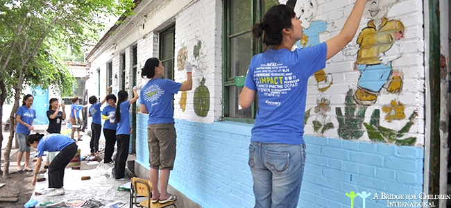 Discovery Channel volunteers painting schools at a migrant elementary school.