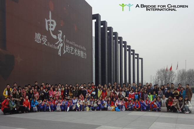 SEI Volunteers, ABC staff and volunteers, DREAM students and Basketball students pose for a group photo outside the National Film Museum after a wonderful day
