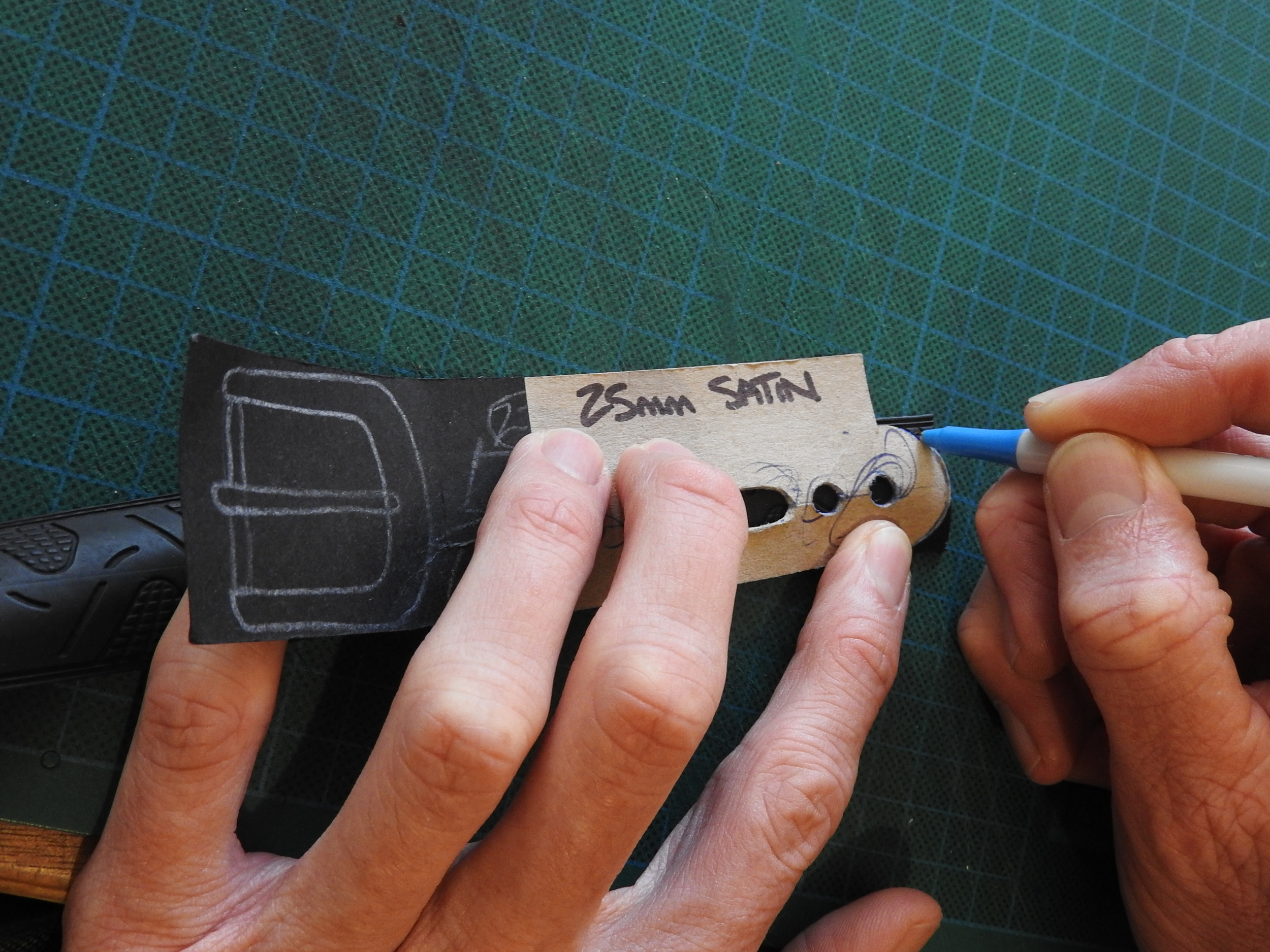 Templates make sure every belt is precisely marked.