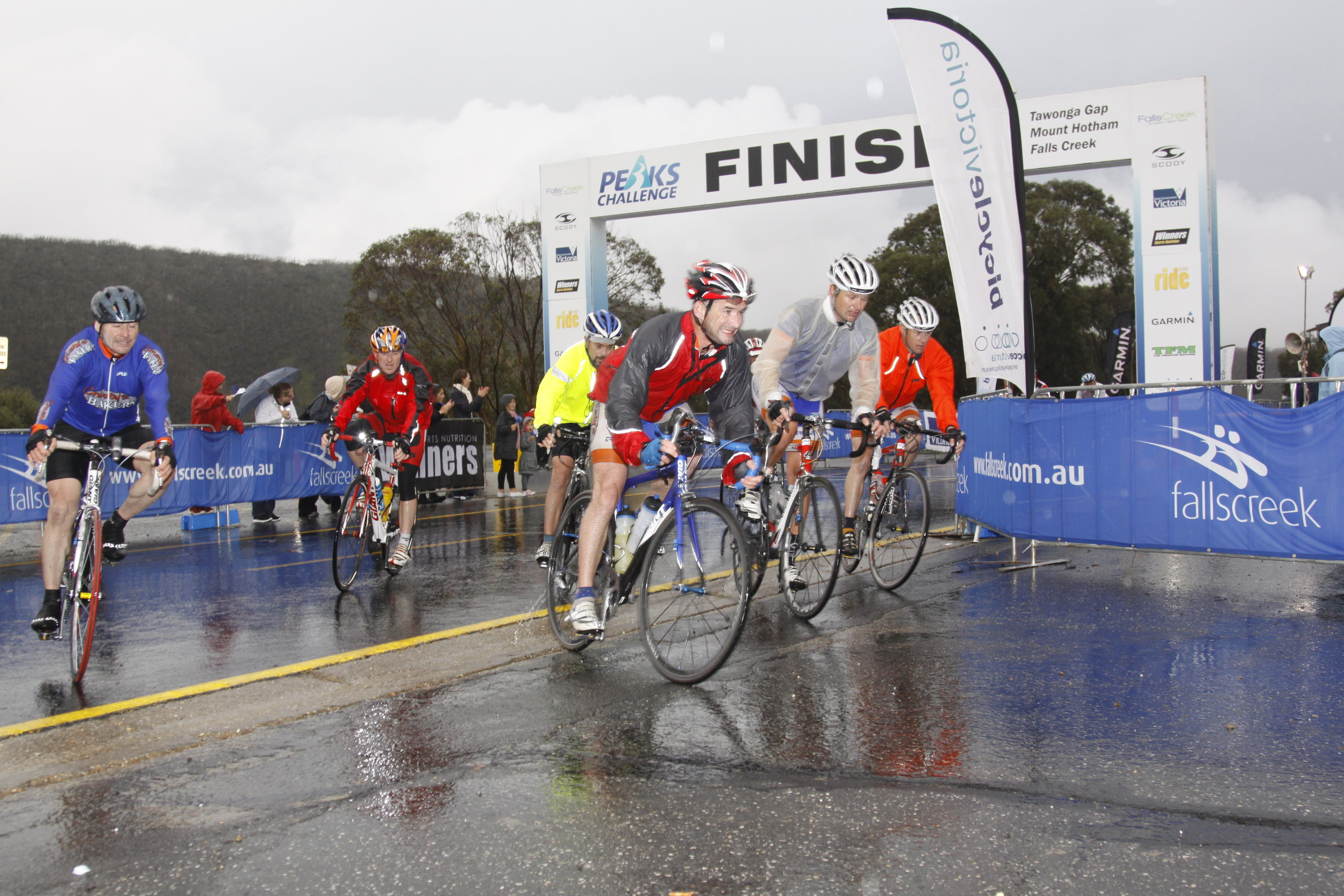 Group of male riders  the finish line.jpg