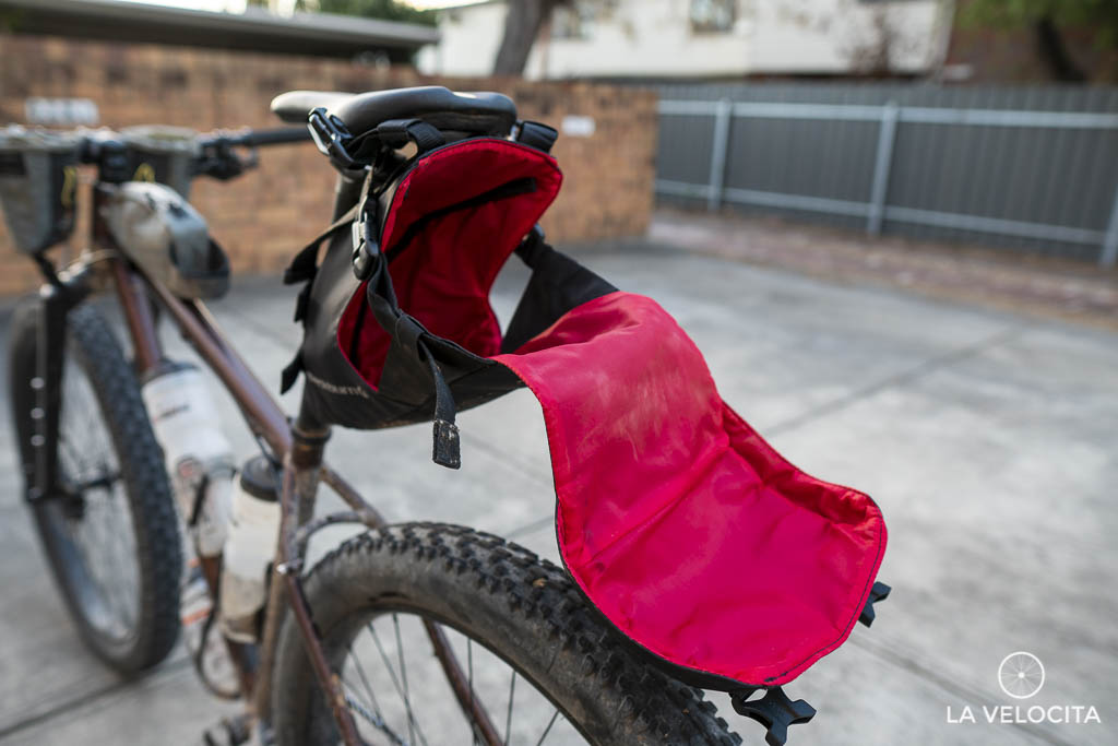 The cradle wraps around the dry bag to keep everything secure