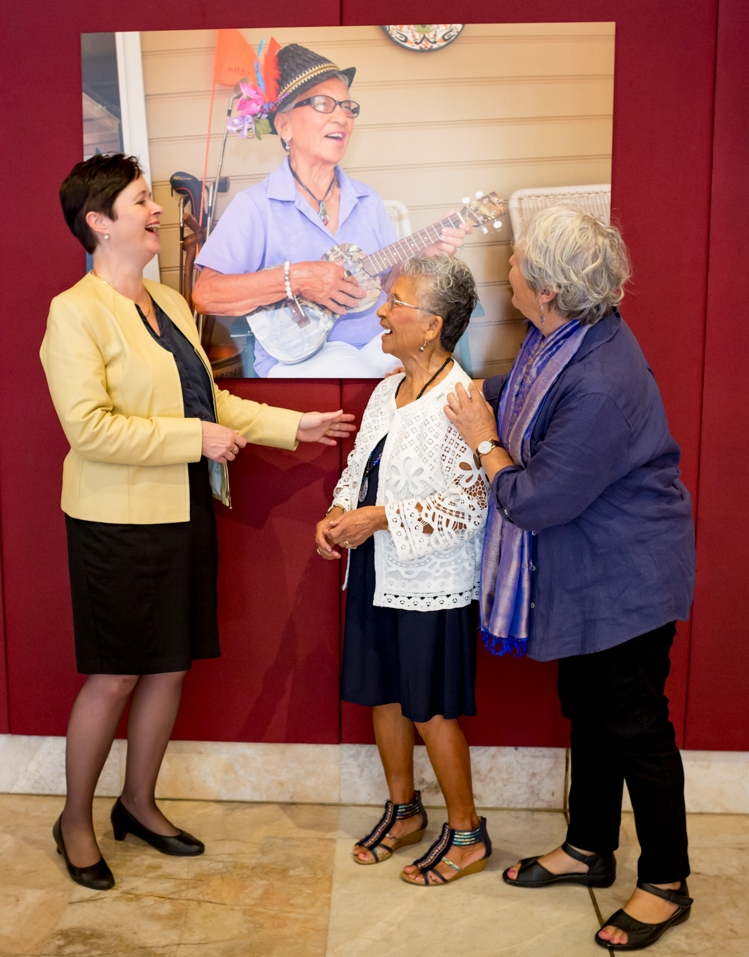Rita Lucas (centre), a subject from 'The Art of Ageing', sees her photograph in story at Parliament House. She is joined by Minister for Ageing Tanya Davis (left) and photographer Julie Slavin (right).