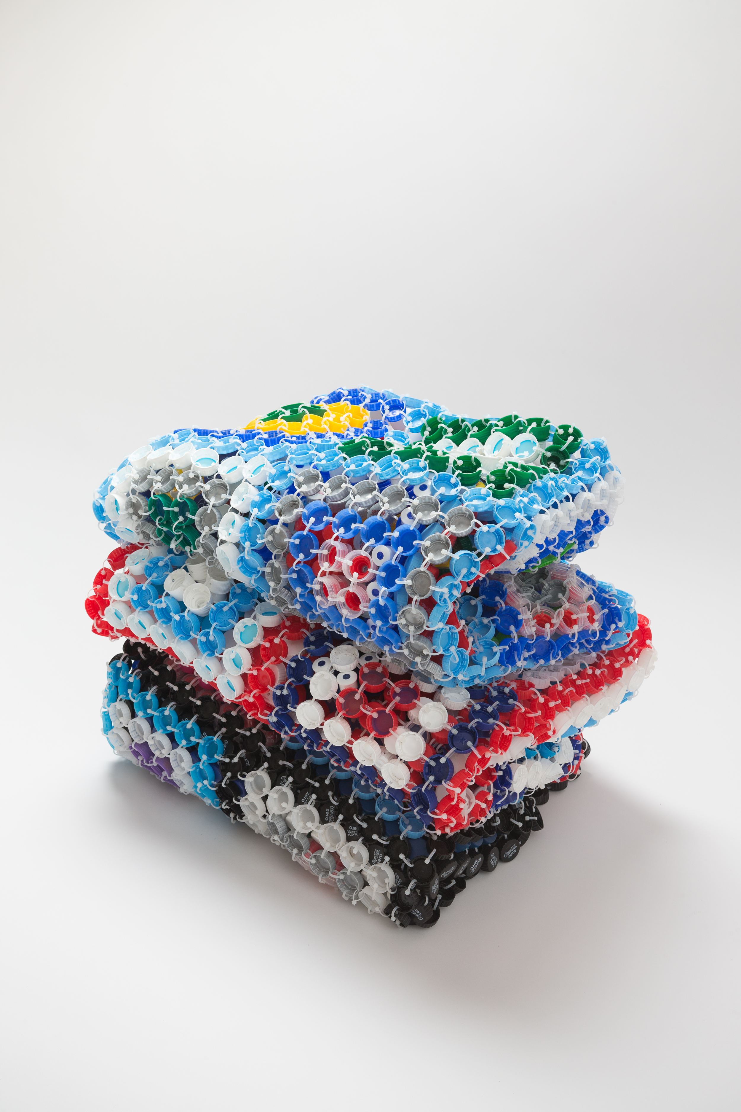 Shared Comfort   2014  Plastic bottle caps & cable ties  50 x 50 x 40cm  photographer James Field, courtesy of Adelaide Central School of Art